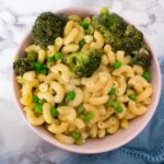 Here's a spin on my favourite comfort food - Mac and 4 Cheese with Broccoli and Peas! Cheesy but with greens mixed in!
