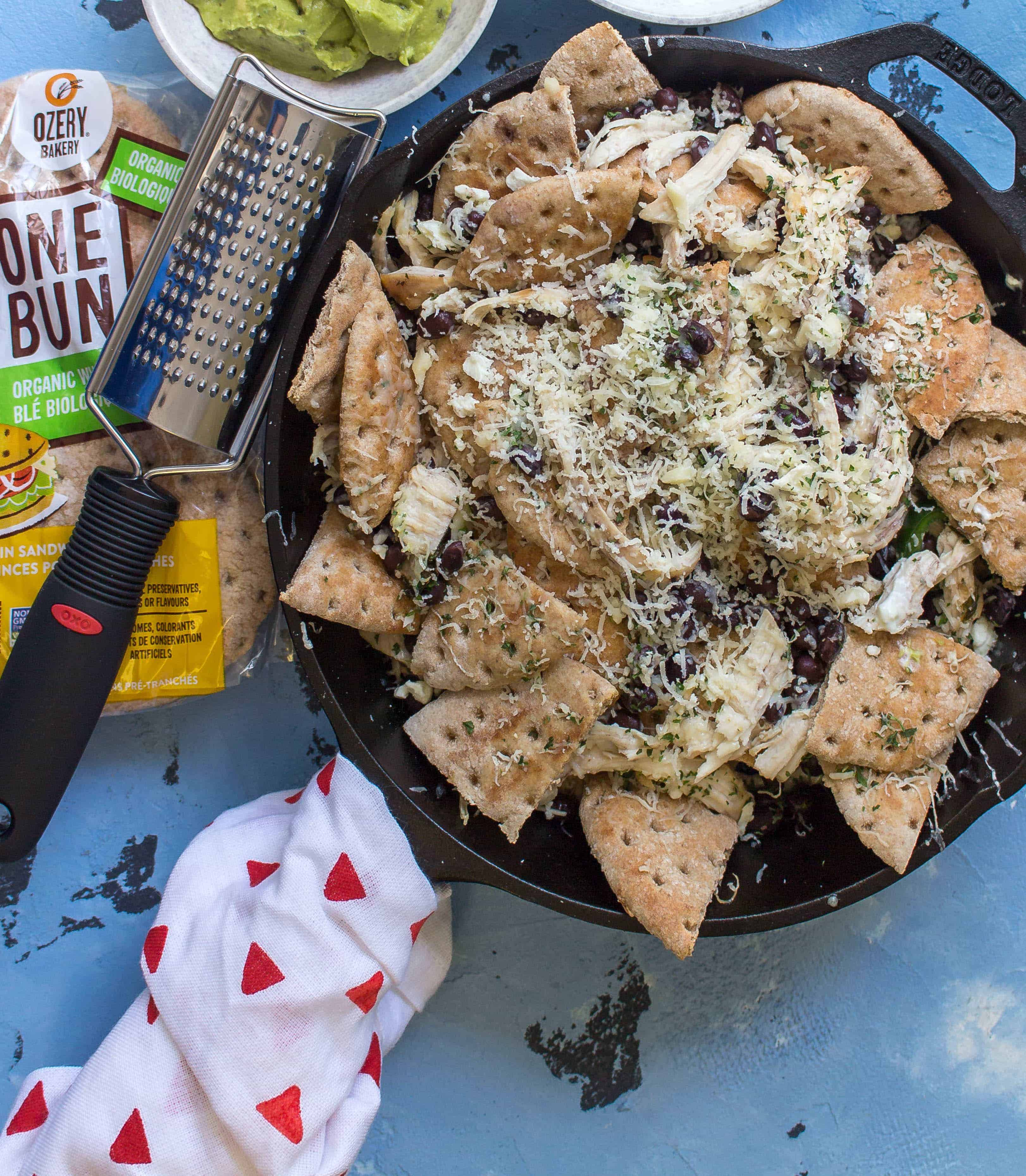 This Greek Inspired Chicken Nachos dish is fun and delicious plus it can be eaten two ways!