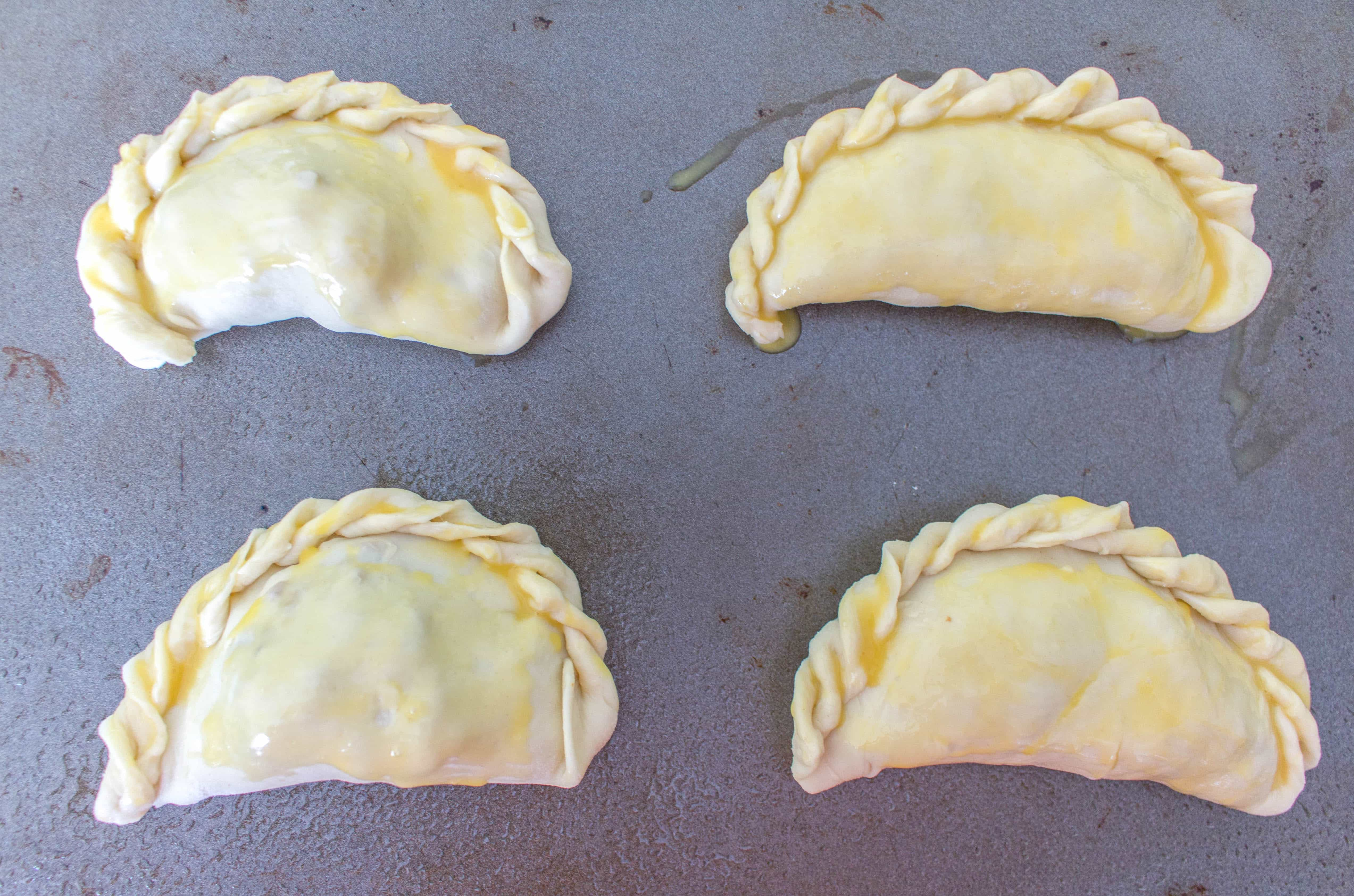 Delicious, flakey, and stuffed full of beef, these freezer friendly beef empanadas are the perfect snack! Prep these freezer friendly beef empanadas ahead of time, freeze them, and then pop them into the oven whenever you're ready to eat them!