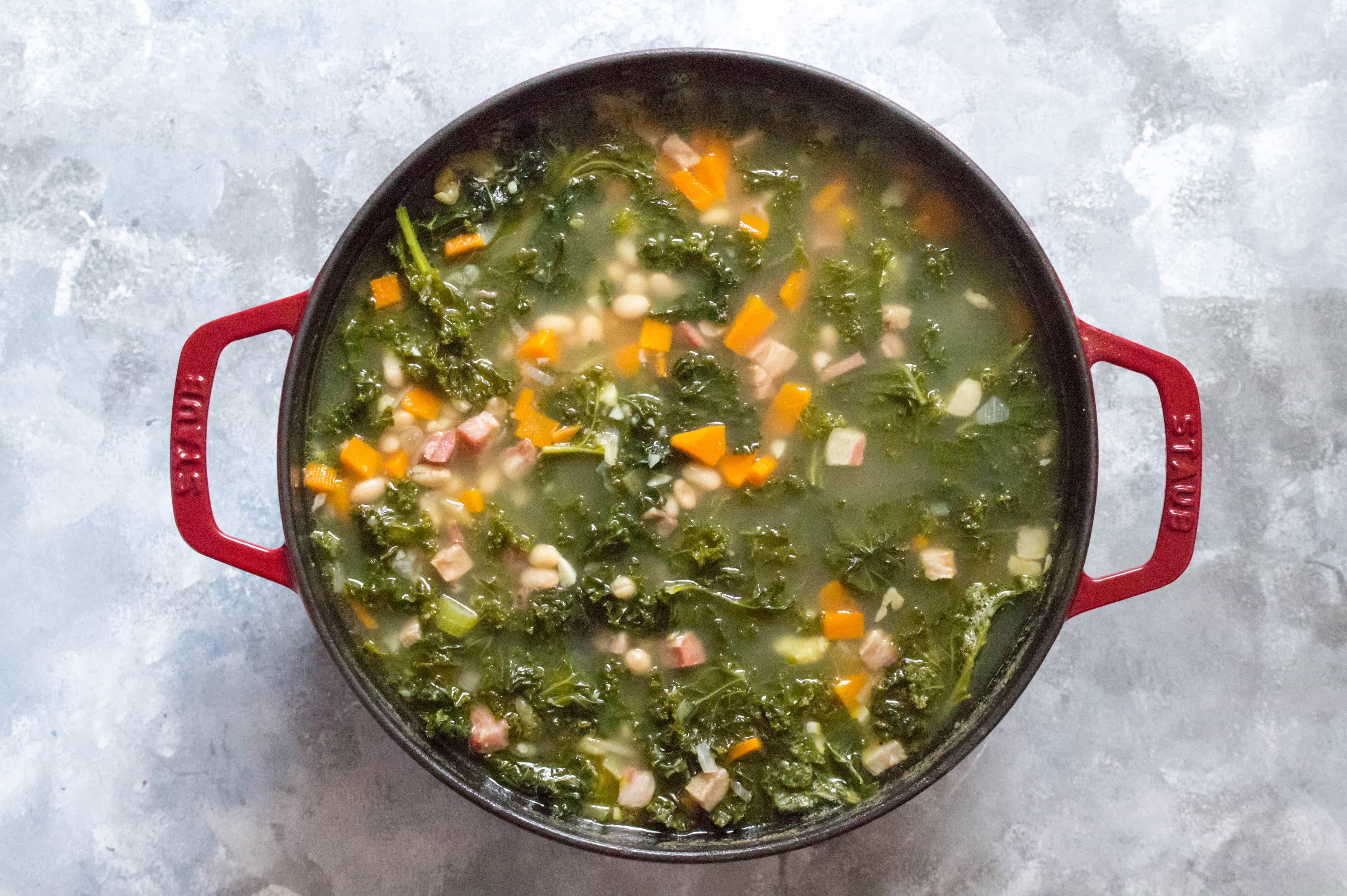 Tuscan White Bean, Kale, Pancetta, and Polenta Soup in a Staub