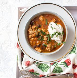 This Healthy Instant Pot Turkey and Lentil Chili Recipe is the perfect meal for any night of the week! The turkey keeps the calories low and the extra boost of lentils in the chili helps keeps you feeling full.