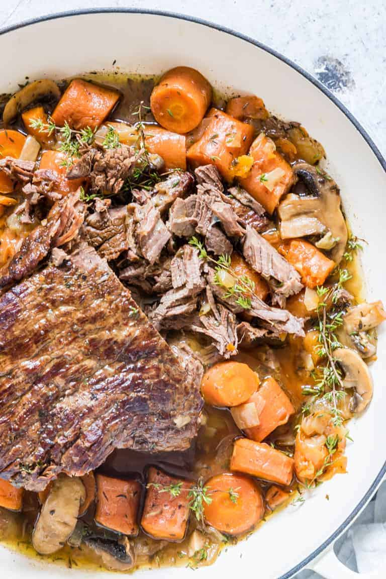 This pot roast recipe (using fresh or frozen meat) is tender, flavourful and the perfect one-pot meal. Suitable for Keto, Paleo, Whole 30 and gluten-free dieters.