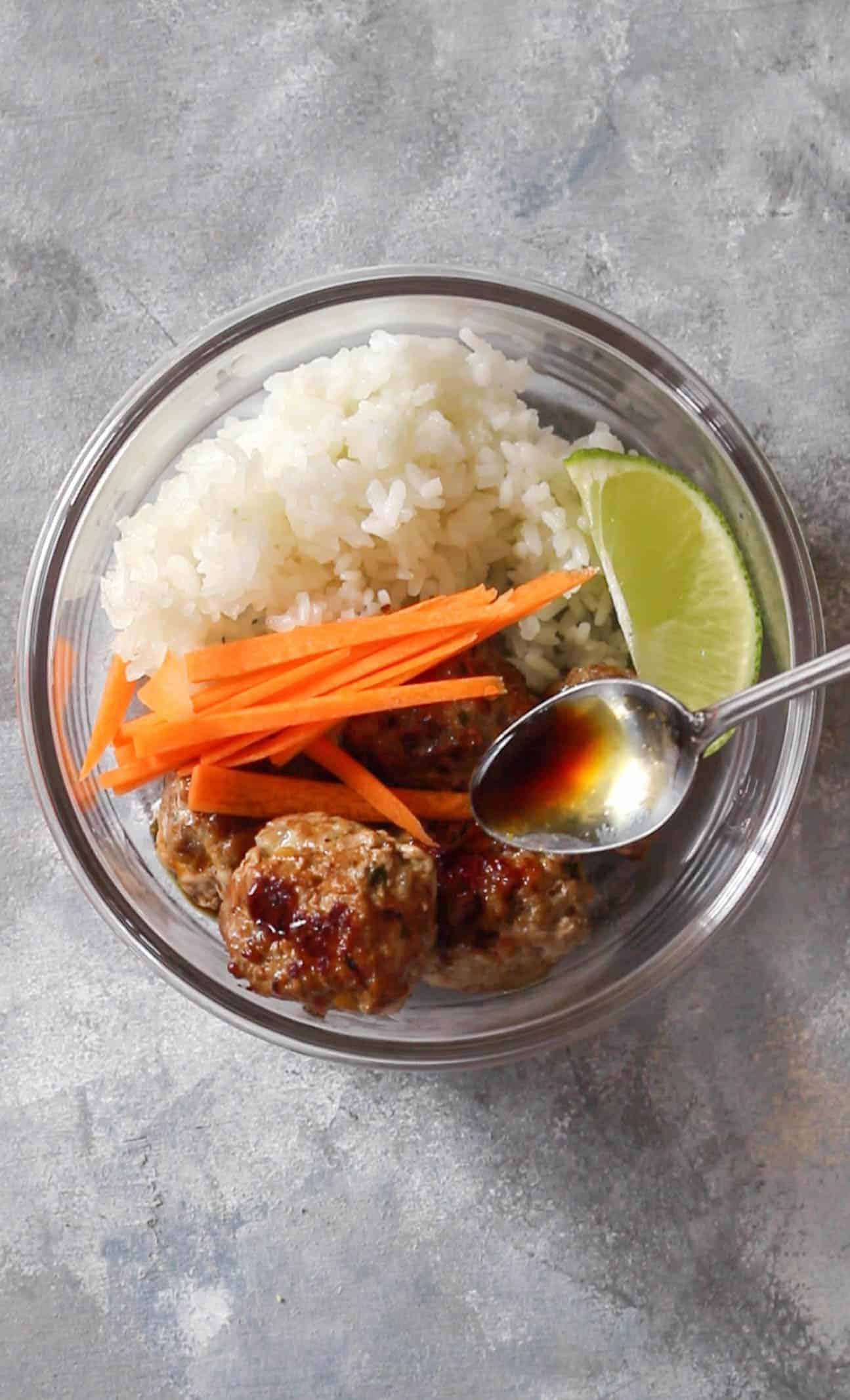 pouring sauce on bun cha meal prep | This Bun Cha Inspired Meatball Meal Prep can be made three ways: Instant Pot, Oven, and Stovetop! A classical Vietnamese recipe made easy!