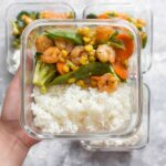 This Sriracha Honey Shrimp Meal Prep is perfect for days where you are craving a stir fry. Made in under 30 minutes, this pan-seared shrimp with veggies mixed in, is the perfect blend of sweet and hot. This Sriracha Honey Shrimp recipe is not only great as a meal prep but perfect as a quick weeknight dinner.