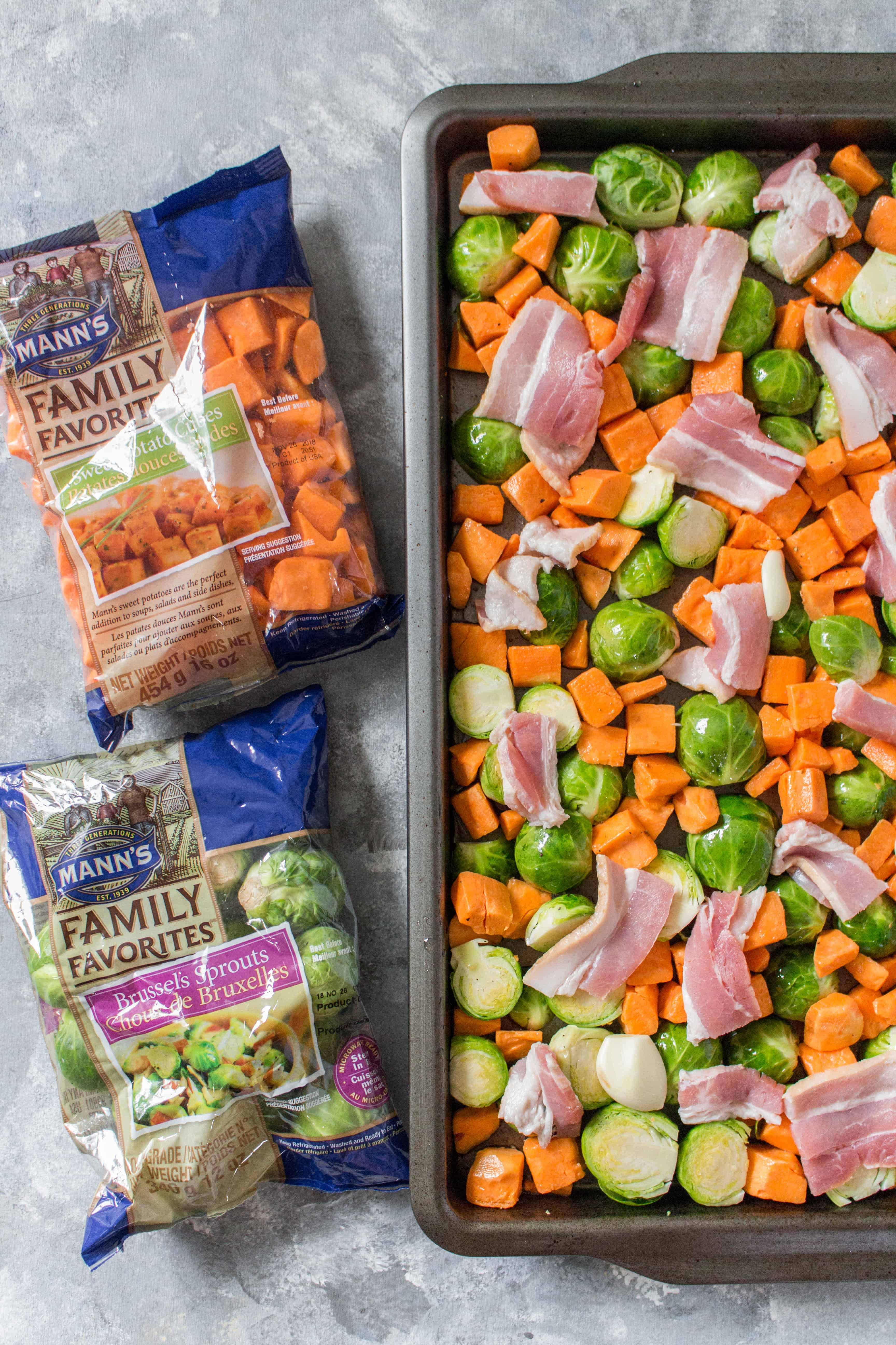 Looking for an easy holiday side dish? This Easy Roasted Brussels Sprouts with Sweet Potato, Bacon, and Almonds takes seconds to prep and goes with everything!