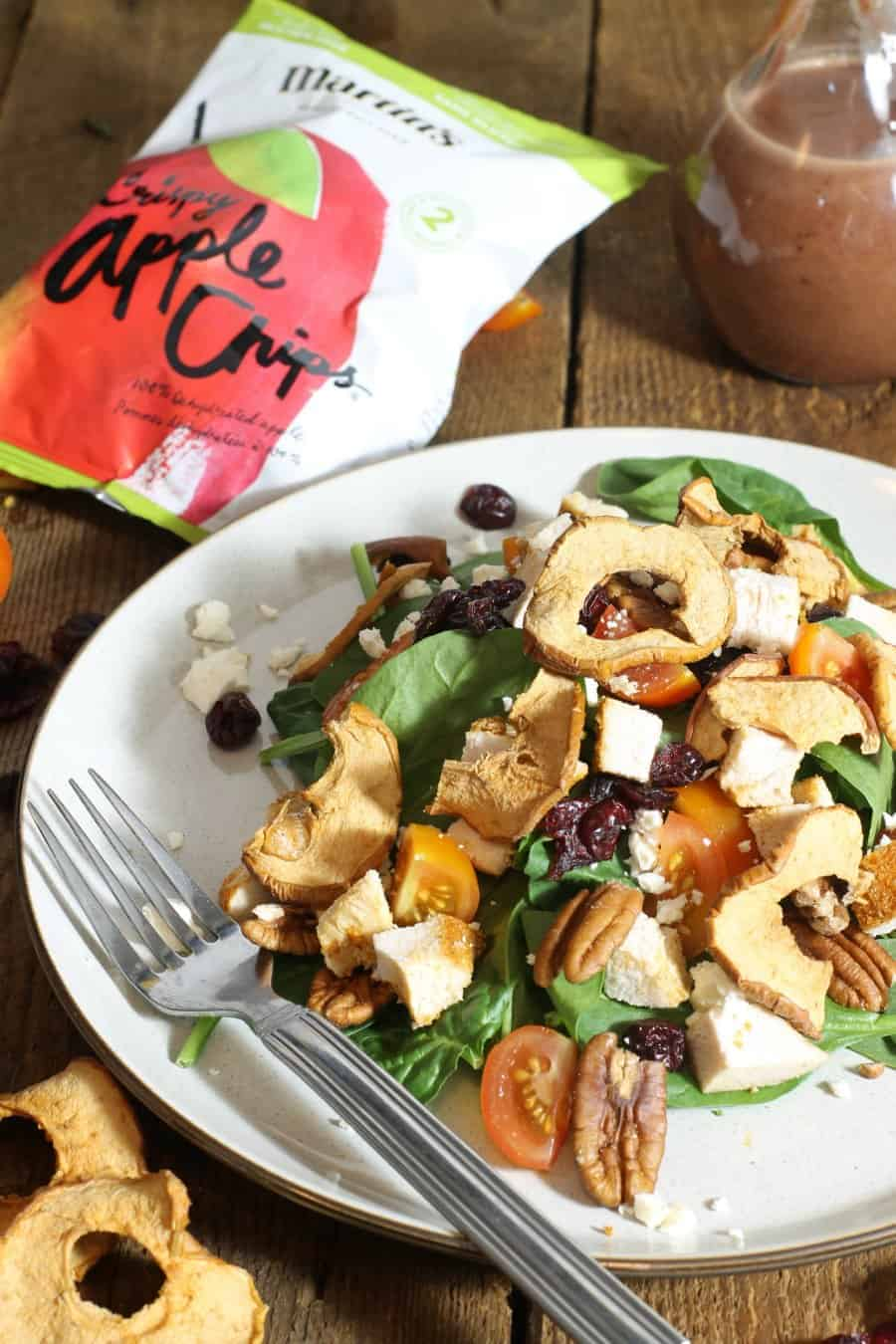 A simple chicken spinach salad with a crispy twist! Martin's Crispy Apple Slices are mixed with baked chicken, pecans, cherry tomatoes, and feta, to create the perfect back-to-school/work salad meal.