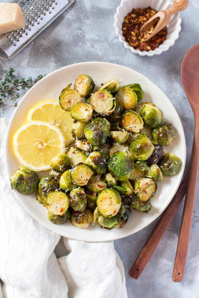This delicious Lemon Parmesan Brussels Sprouts recipe makes for the perfect side dish or as a fresh tangy side to a meal prep for the week!