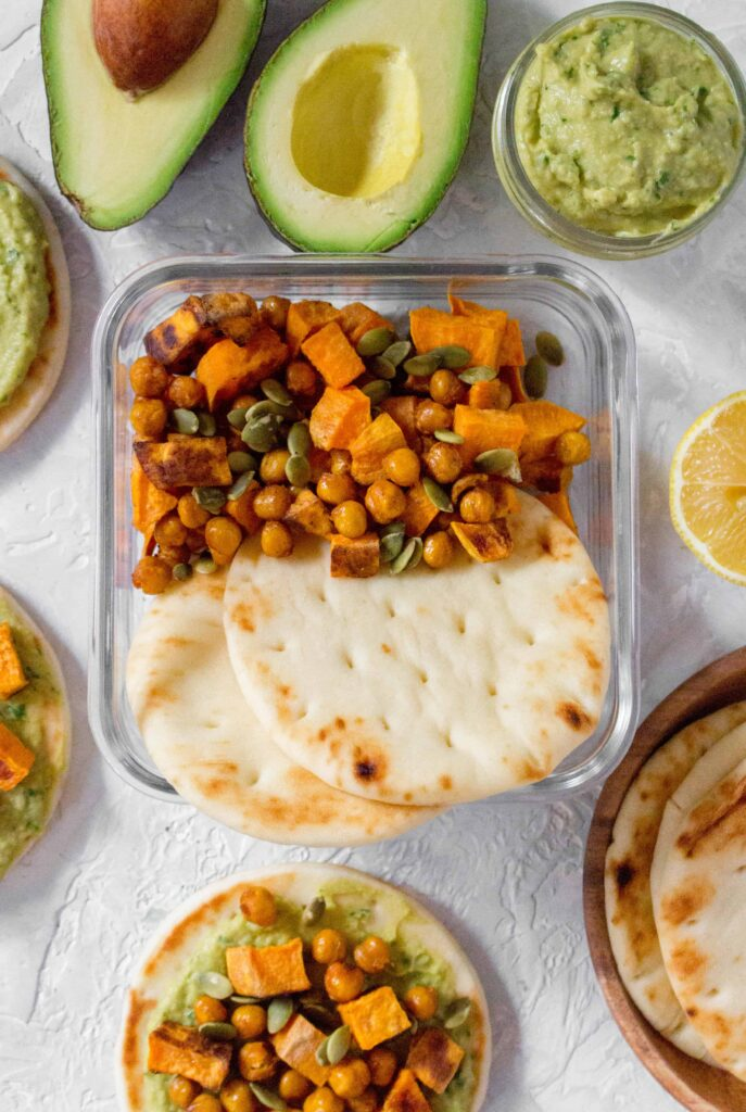 This Creamy Avocado Hummus with Roasted Chickpeas and Sweet Potato on Mini Pitas are the perfect grab and go lunch.