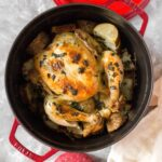 Crispy skin, delicious flavour, and oh so moist, this Garlic Herb Butter Roasted Chicken in a Dutch Oven is going to have you drooling!