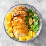 This easy Mango Chili Lime Chicken meal prep is coated with a sweet and spicy marinade. Delicious hot or cold.