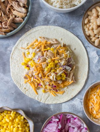 Freezer Chicken Burritos are super handy to have in the freezer. Meal prep these lazy chicken burritos this weekend!