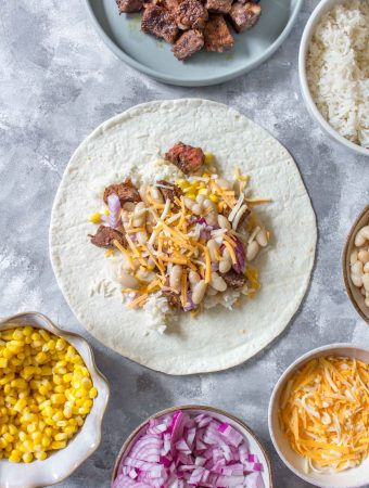 Freezer Steak Burritos are super handy to have in the freezer. Meal prep these lazy chicken burritos this weekend!