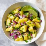 This easy peasy no fuss pineapple salsa barely takes any time to put together! Perfect as a side dish and great for potlucks!