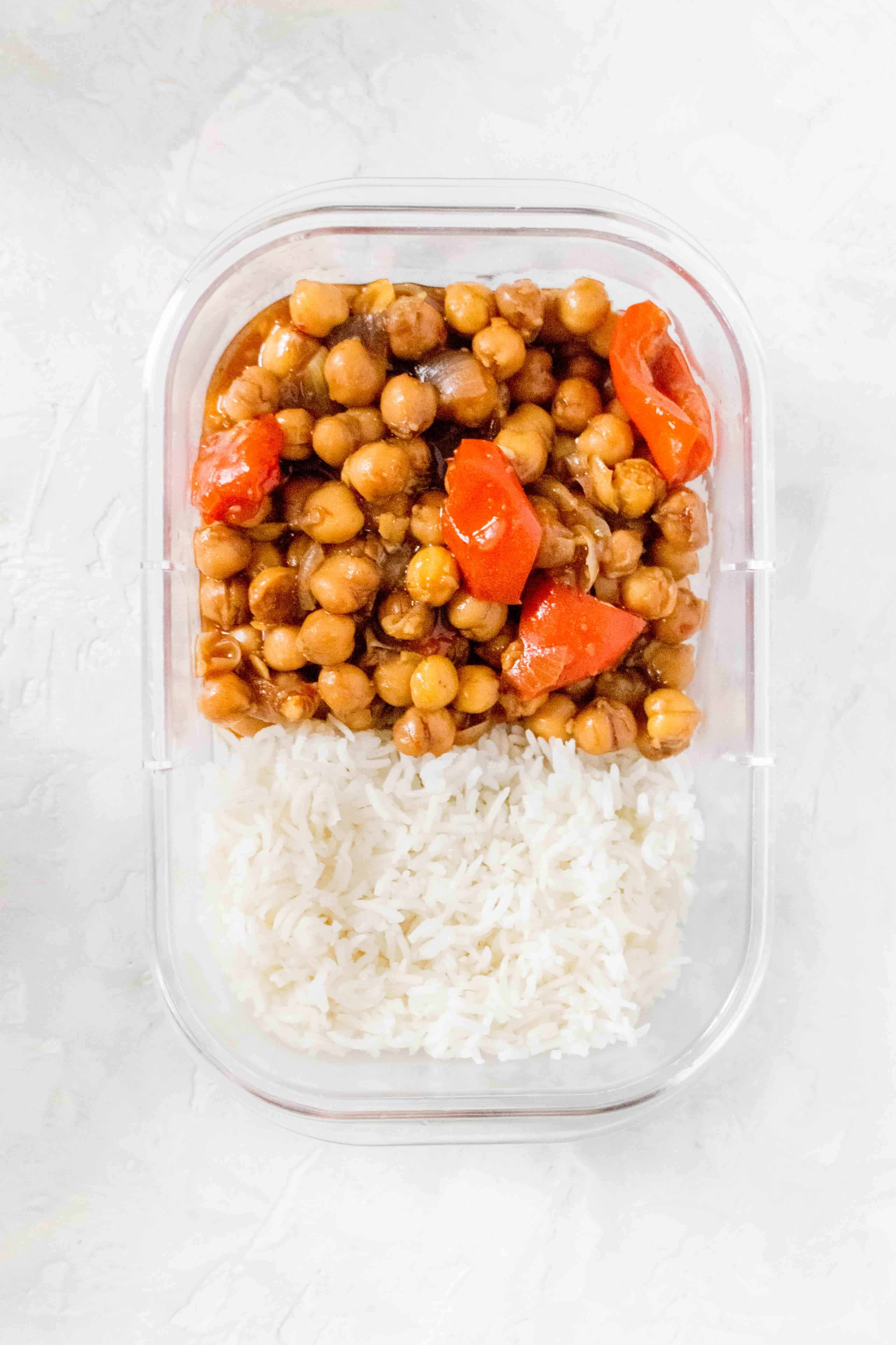 Rubbermaid Brilliance container with Instant Pot Kung Pao Chickpeas with rice stored inside.