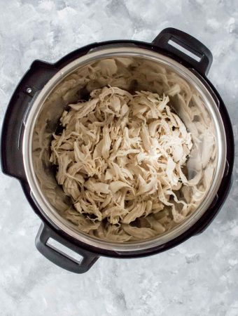 This Instant Pot Shredded Chicken is perfectly moist, tender, and easy to make! Use this shredded chicken for your meal prep, freeze for later, or as an addition to any meal you've got planned for the week!