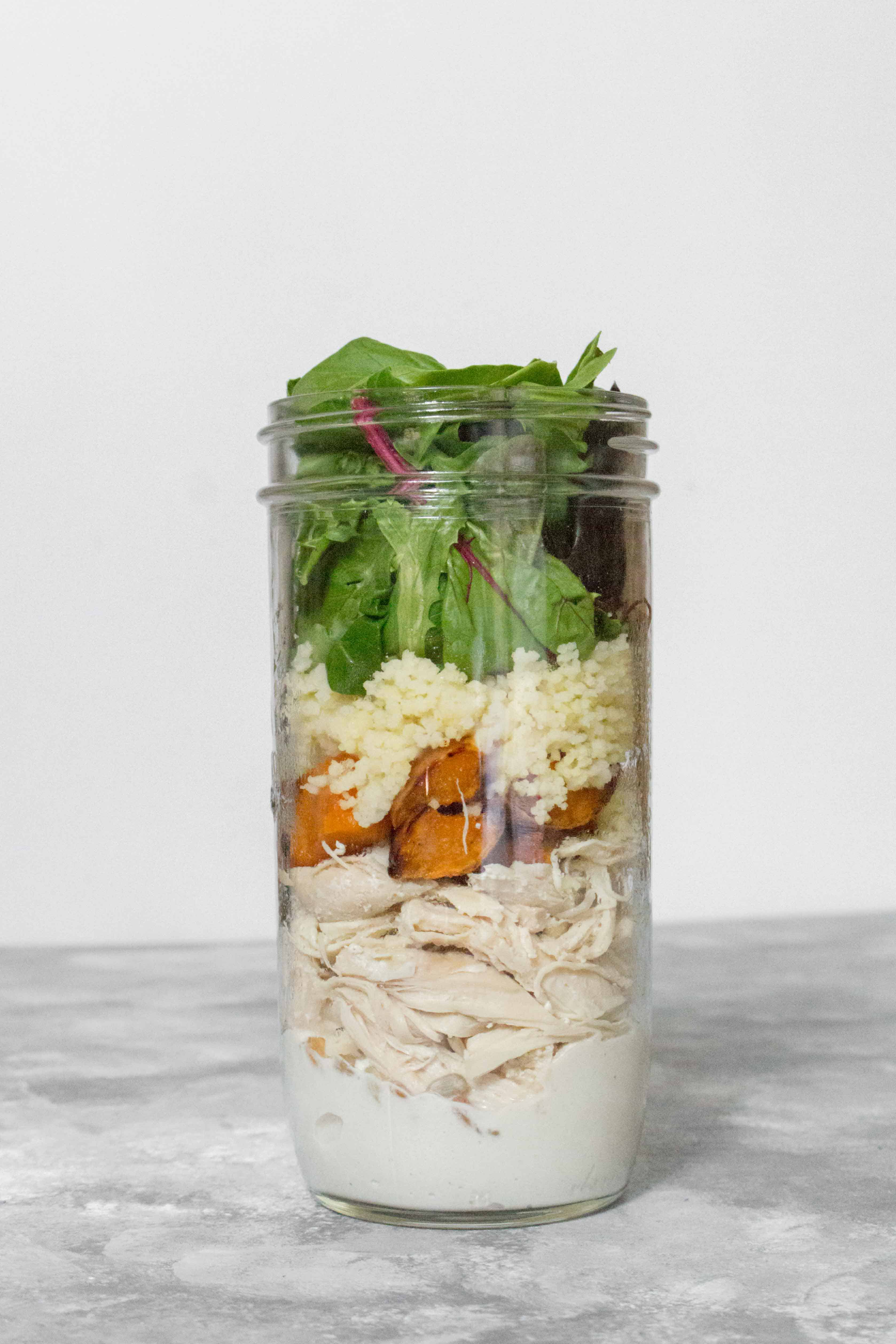 This Summer Couscous Chicken Mason Jar Salad is super easy to make and will make your work lunches much more exciting!