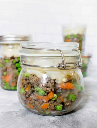 Craving some comfort food but don't want to feel weighed down? This Mason Jar Shepherd's Pie Meal Prep is packed with veggies and is the perfect grab and go lunch!