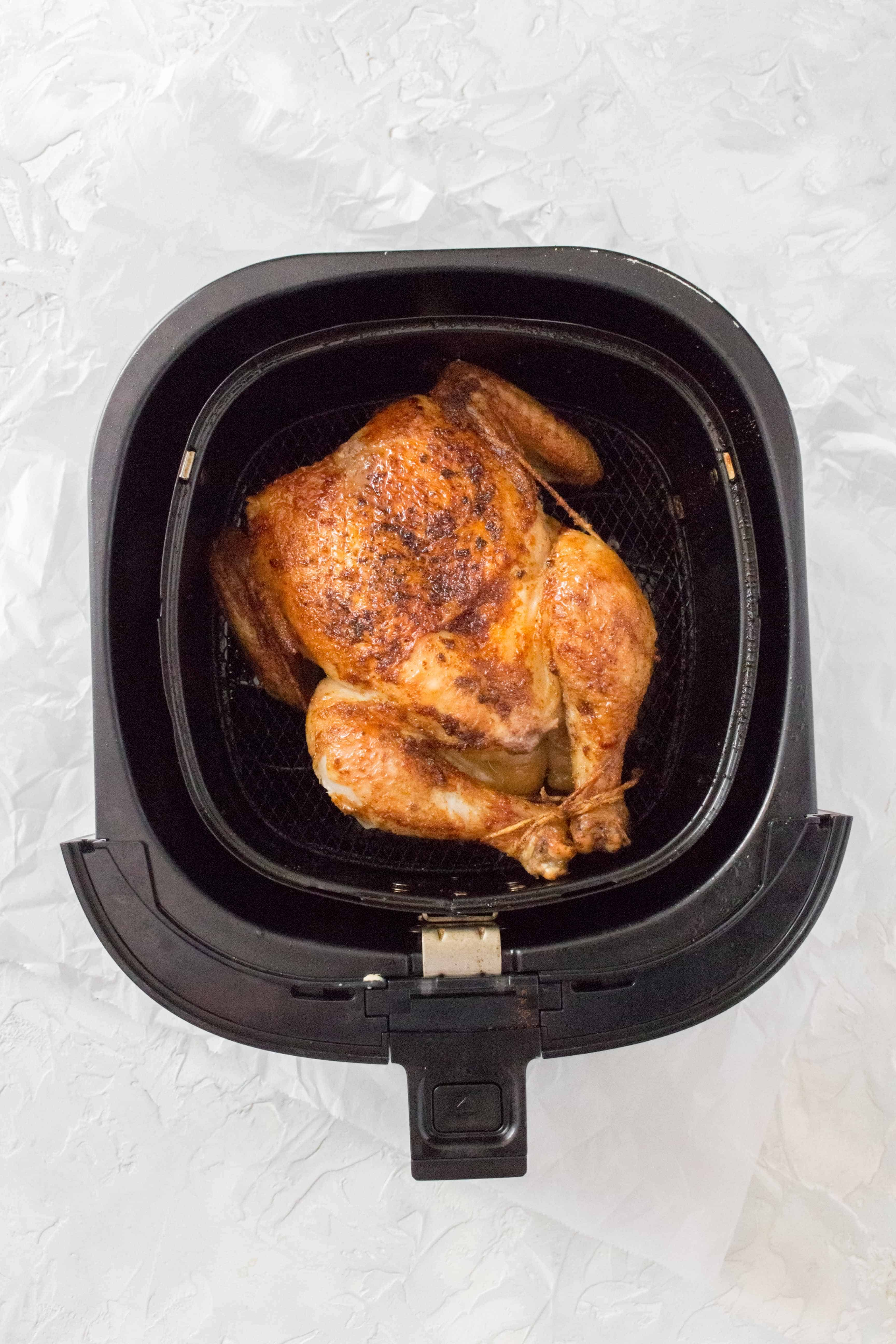 Got an air fryer and want a juicy and tender roast chicken? Perfectly moist with crispy skin, make this whole chicken in an air fryer in under 30 minutes.