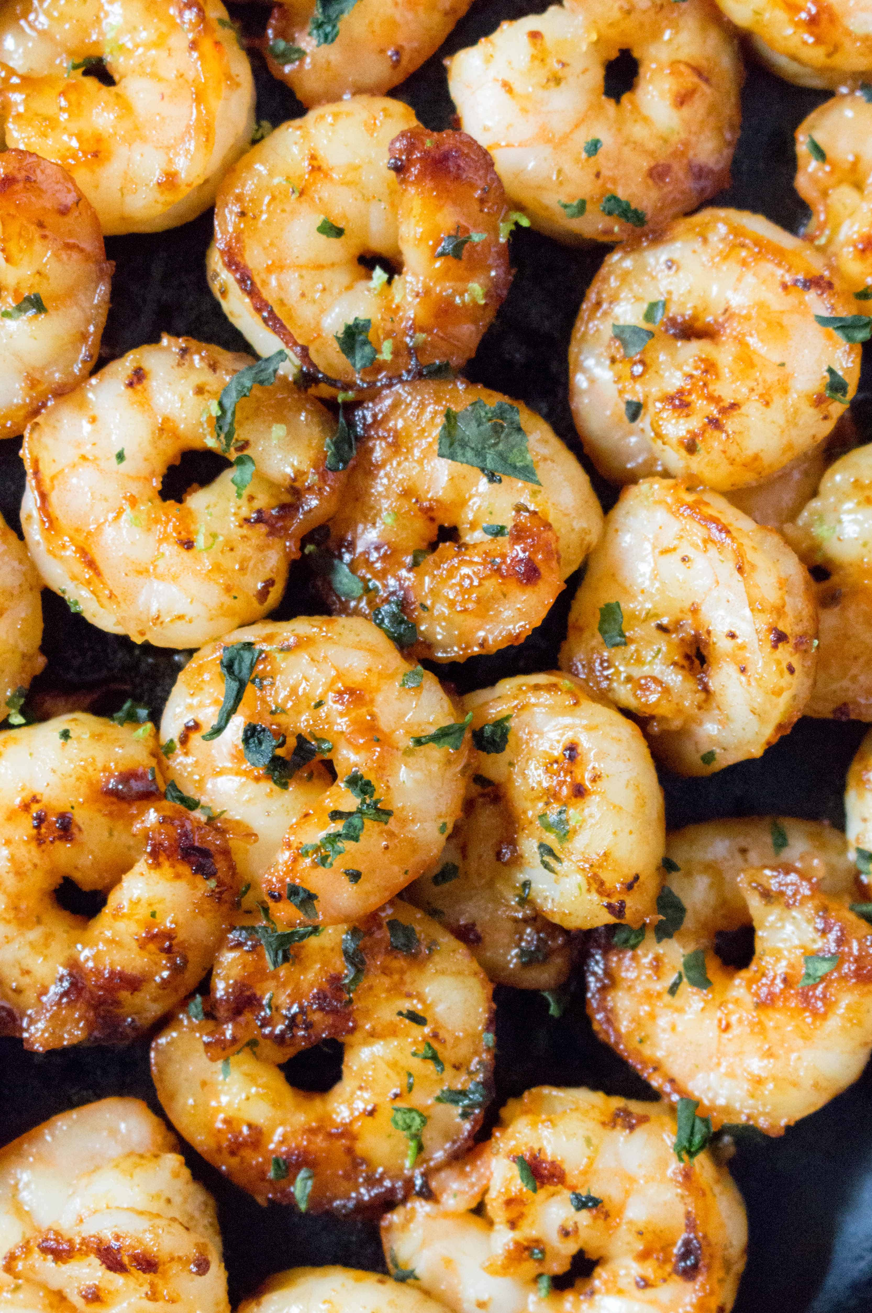 This Honey Garlic Lime Shrimp is perfectly pan seared, sweet and garlicky. Make this for your dinner or meal prep in under 20 minutes.