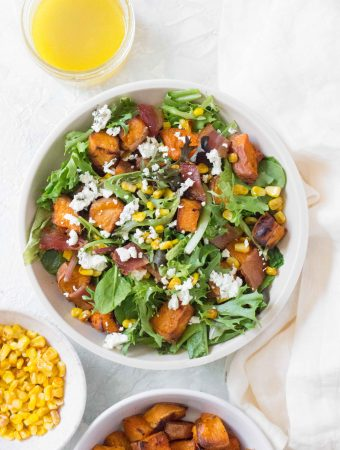 This Roasted Sweet Potato Salad with Corn and Bacon is the perfect salad for your next get together!