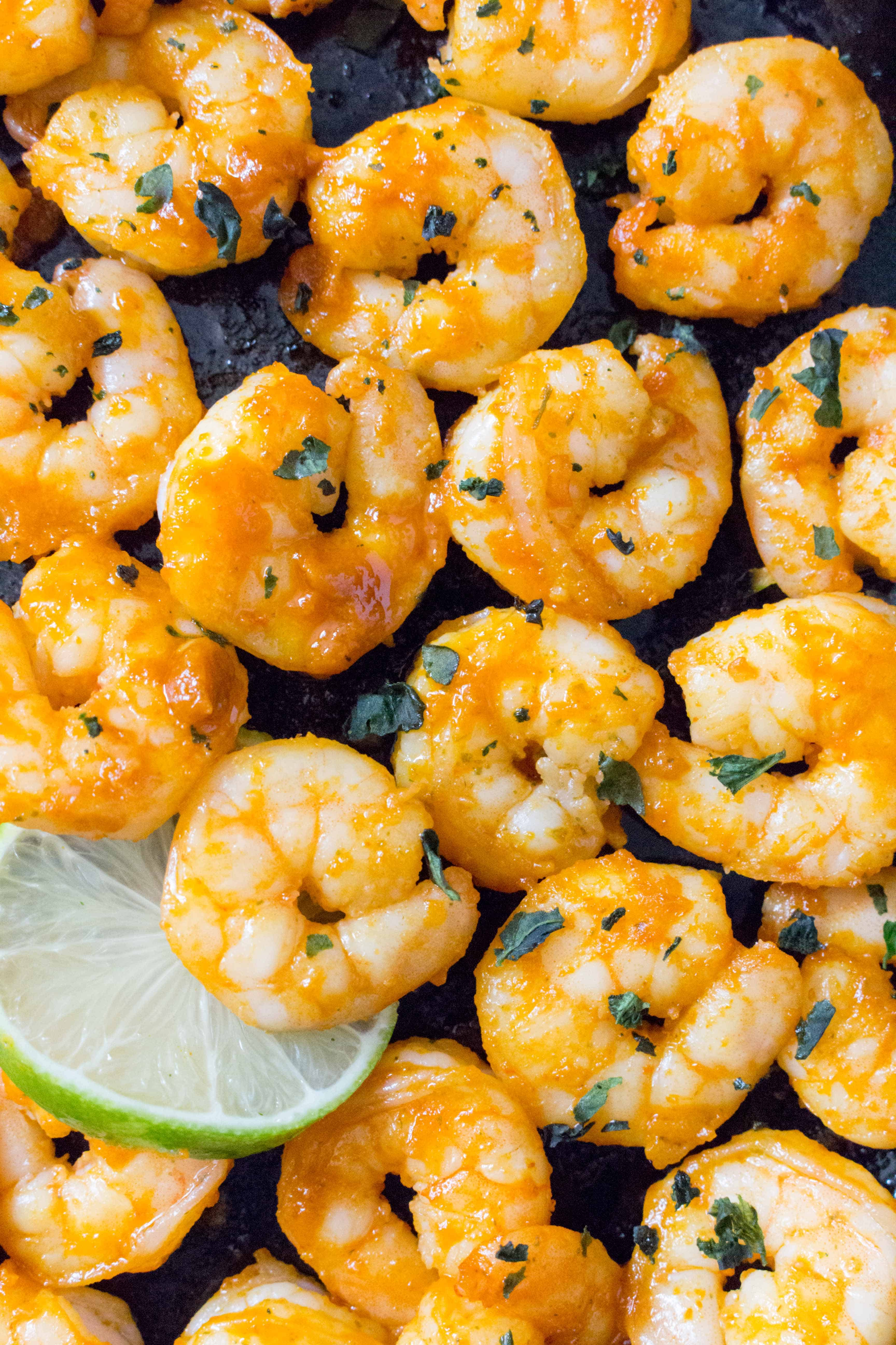 Close up of Sriracha Lime Shrimp in a cast iron.