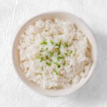 This easy Coconut Rice is the perfect side dish! Make it in a couple of minutes on the stovetop with only a couple simple ingredients!