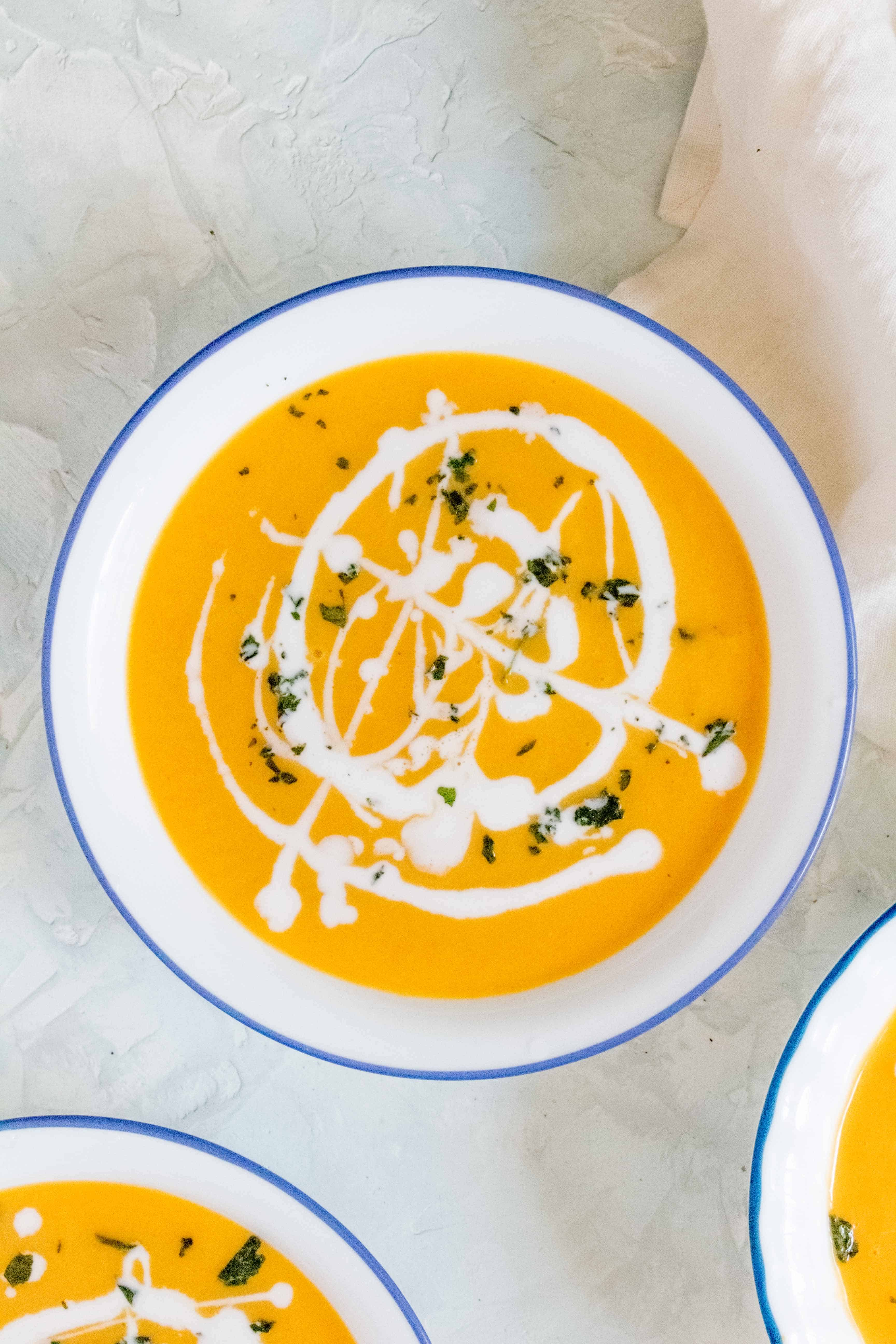 This Instant Pot Thai Carrot Sweet Potato Soup is the perfect mix of sweet with a hint of heat. Super quick and easy to make, you're going to want to make this regularly!