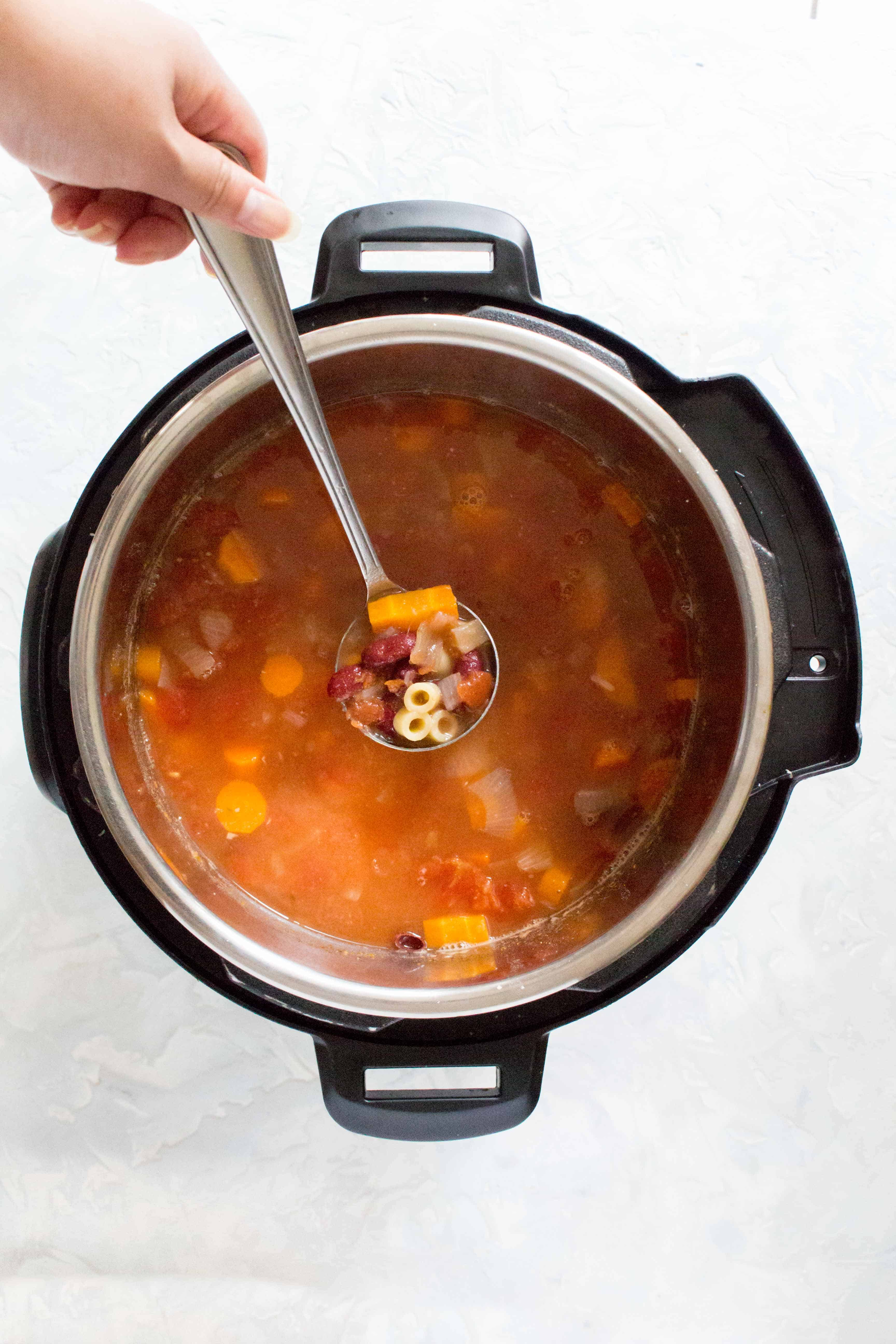 This Instant Pot Vegetable Minestrone with Pasta meal prep is the ultimate vegetarian comfort food! Packed with vegetables and and pasta, you're going to want to grab a big bowl of this.