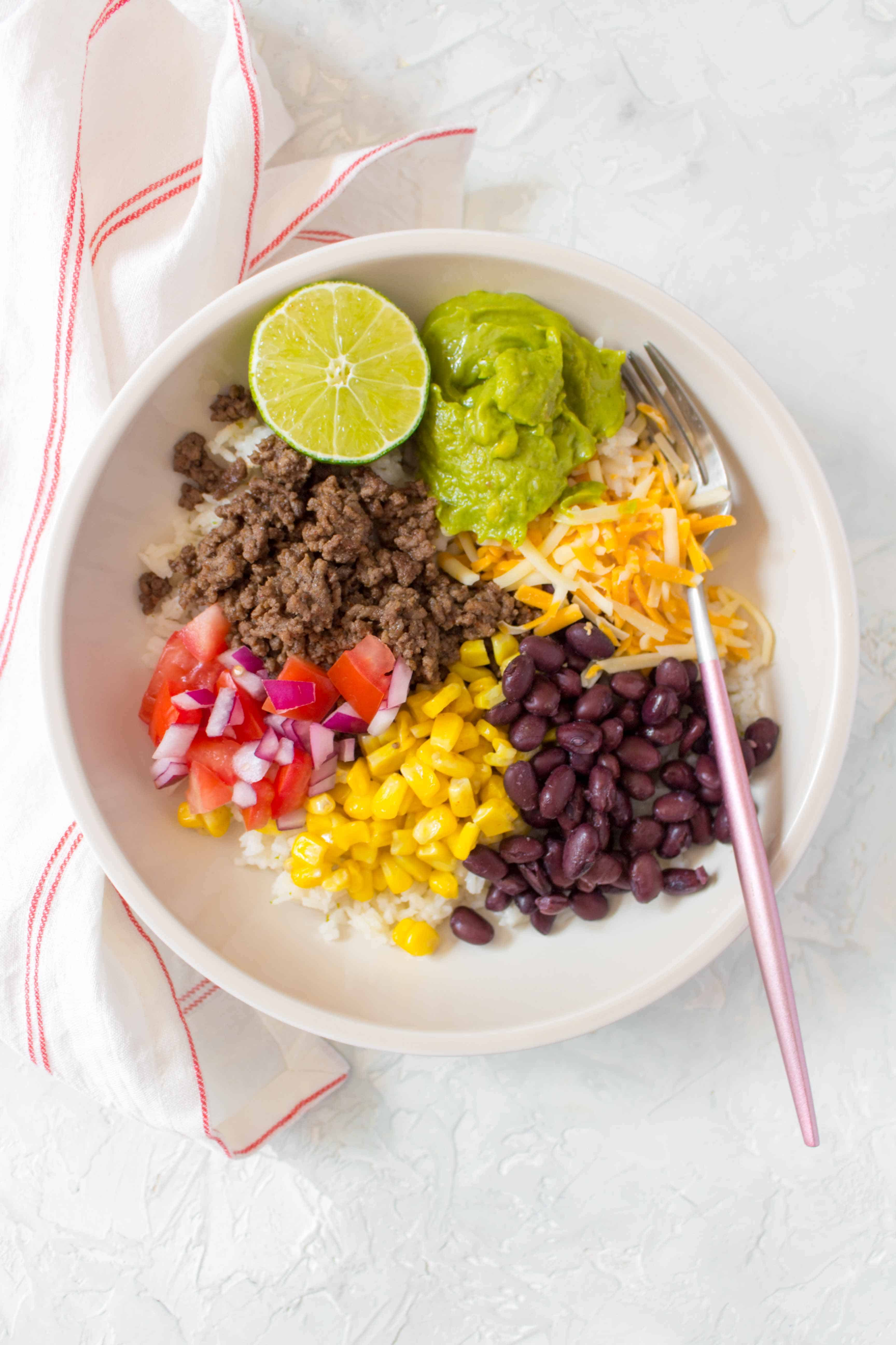 This easy and healthy Taco Bowl Meal Prep is going to become a staple in your meal prep rotation! Simple, filling, and delicious!