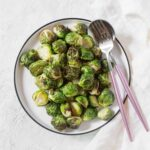 Crispy on the outside, and perfectly tender on the inside, these air fryer Brussels sprouts are going to be a hit! Here's how to make Crispy Air Fryer Brussels Sprouts!