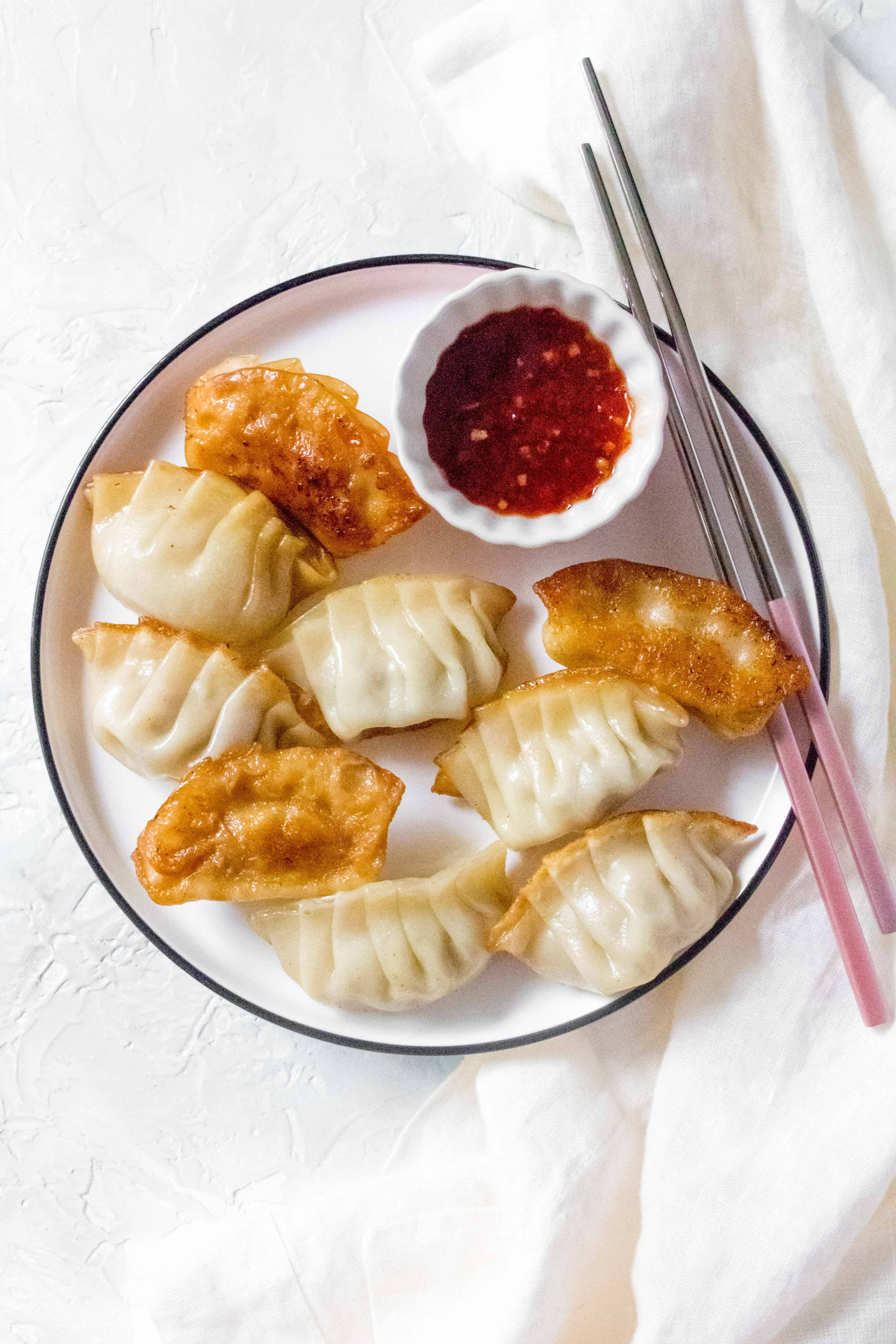 Filled with pork and garlic and have crispy golden bottoms, Pork Potstickers makes for the perfect meal or meal prep. These potstickers are freezer friendly so you can make always have some on hand!