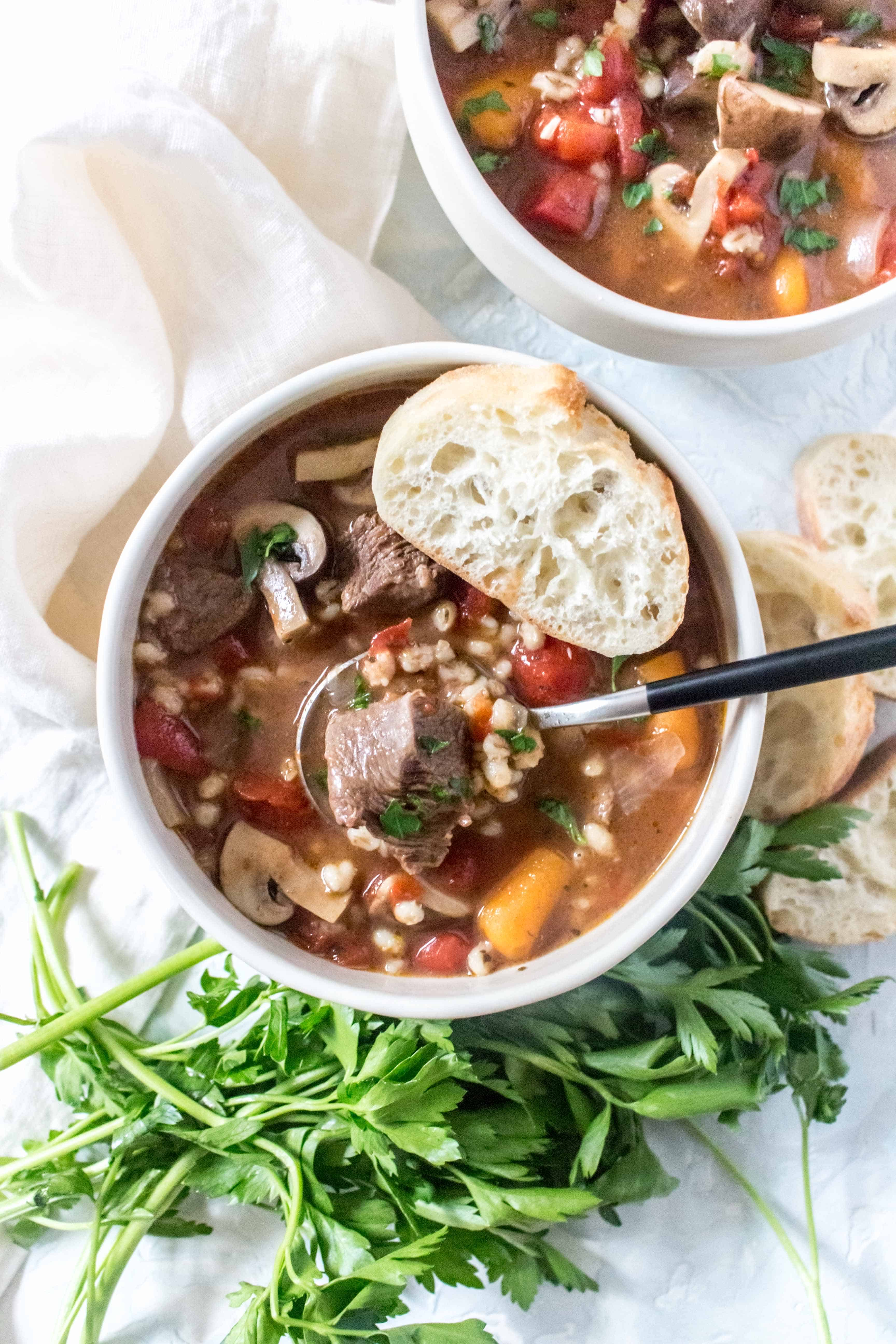 Super rich, freezer friendly, and delicious, this Instant Pot Beef and Barley Soup is comfort in a bowl!