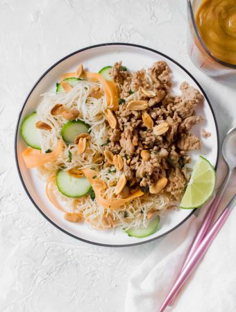 "This Thai Inspired Peanut Noodle Salad with Pork is the perfect last minute dinner or as a meal prep. Coated with a yummy peanut sauce, this ""salad"" hits the spot!"