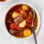 This classic hearty Beef and Tomato Soup warms you up inside out. A childhood favourite, this beef and tomato stew can be made with the Instant Pot or on the stove top!