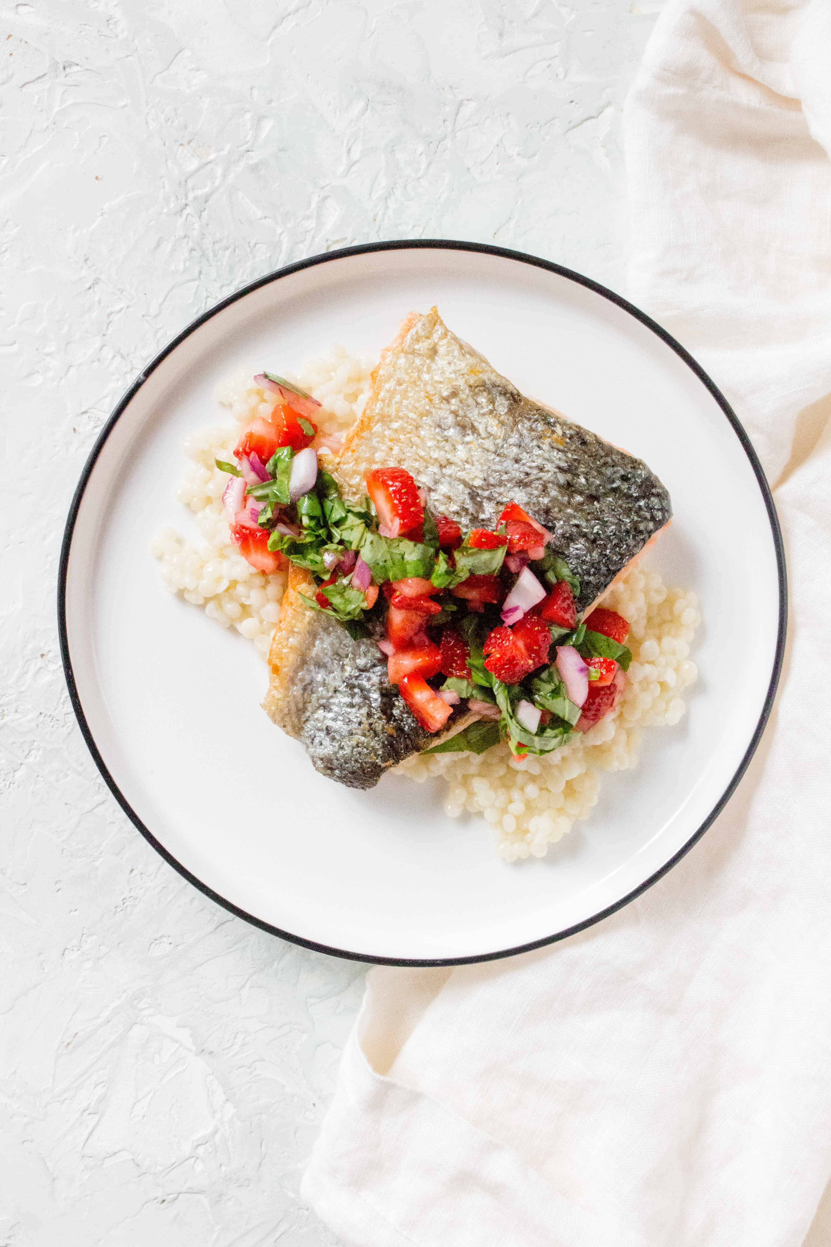 """This Salmon with Strawberry Salsa is the perfect meal to whip up when in need of a last minute """"fancy"""" looking dinner. Pack up leftovers for a cold lunch the next day."""