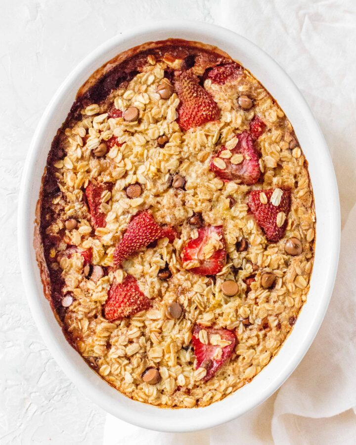 This Strawberry with Chocolate Oatmeal Bake is the perfect breakfast! The pop of colour makes for a pretty looking breakfast for a special occasion but simple enough to work as a weekly meal prep!
