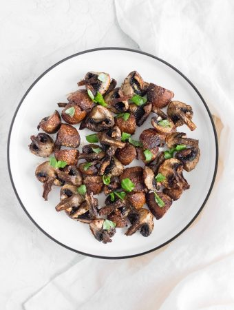 mushrooms made from an air fryer on a plate with garnish