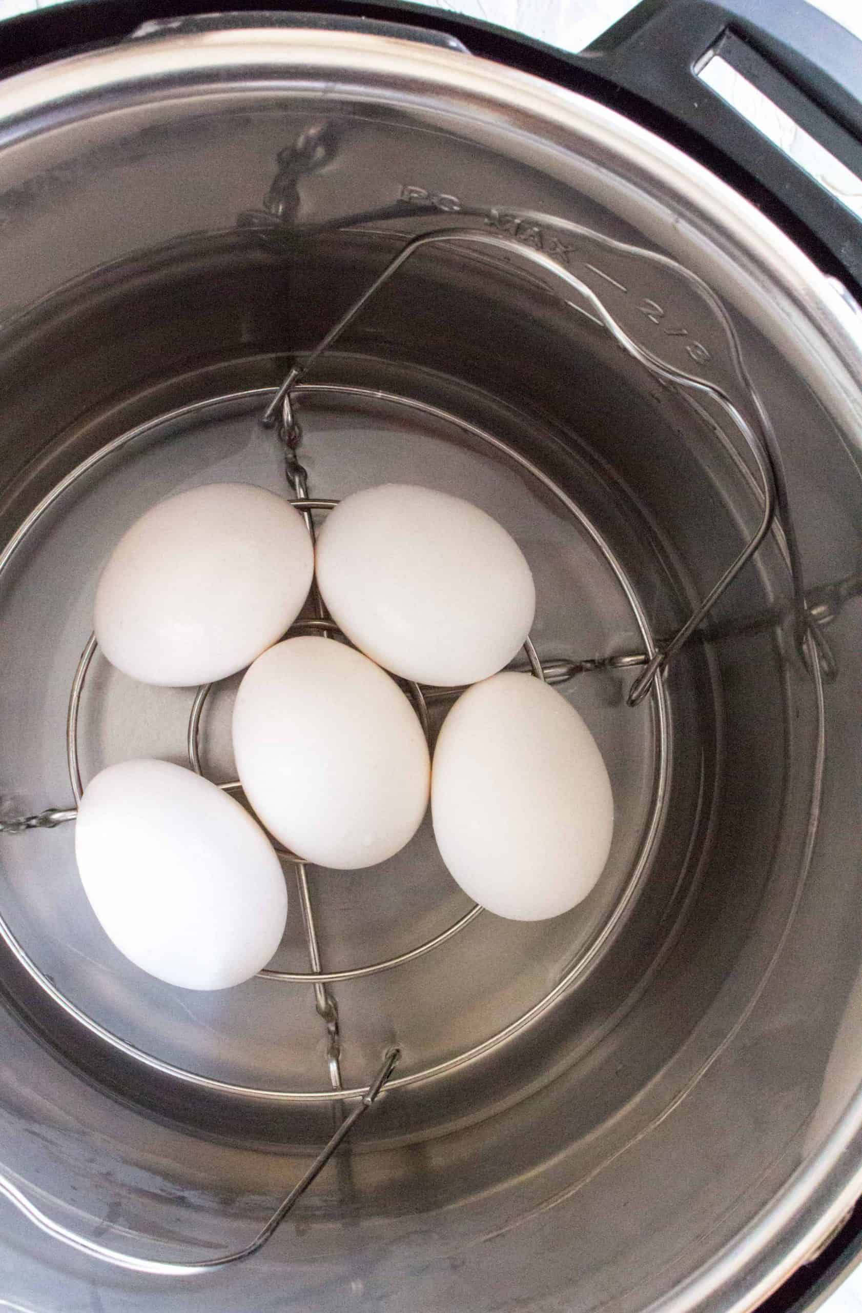 eggs inside of an instant pot on a trivet