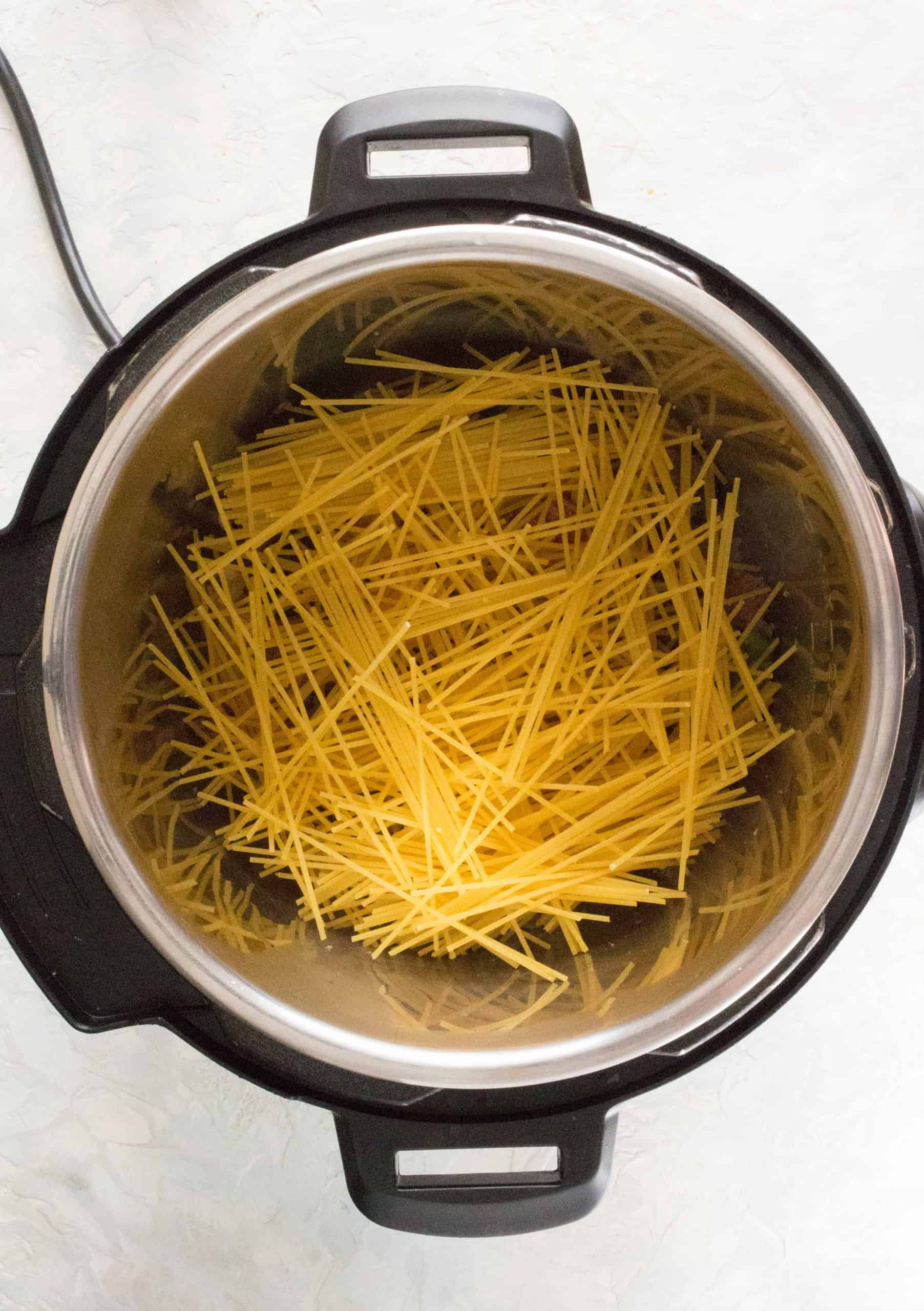 layer your spaghetti noodles in fanned out batches on top of your beef.