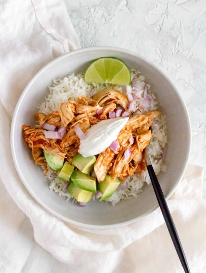This Instant Pot Cilantro Lime Salsa Chicken is so easy to make! Use the shredded chicken in a bowl, tacos, or burritos!