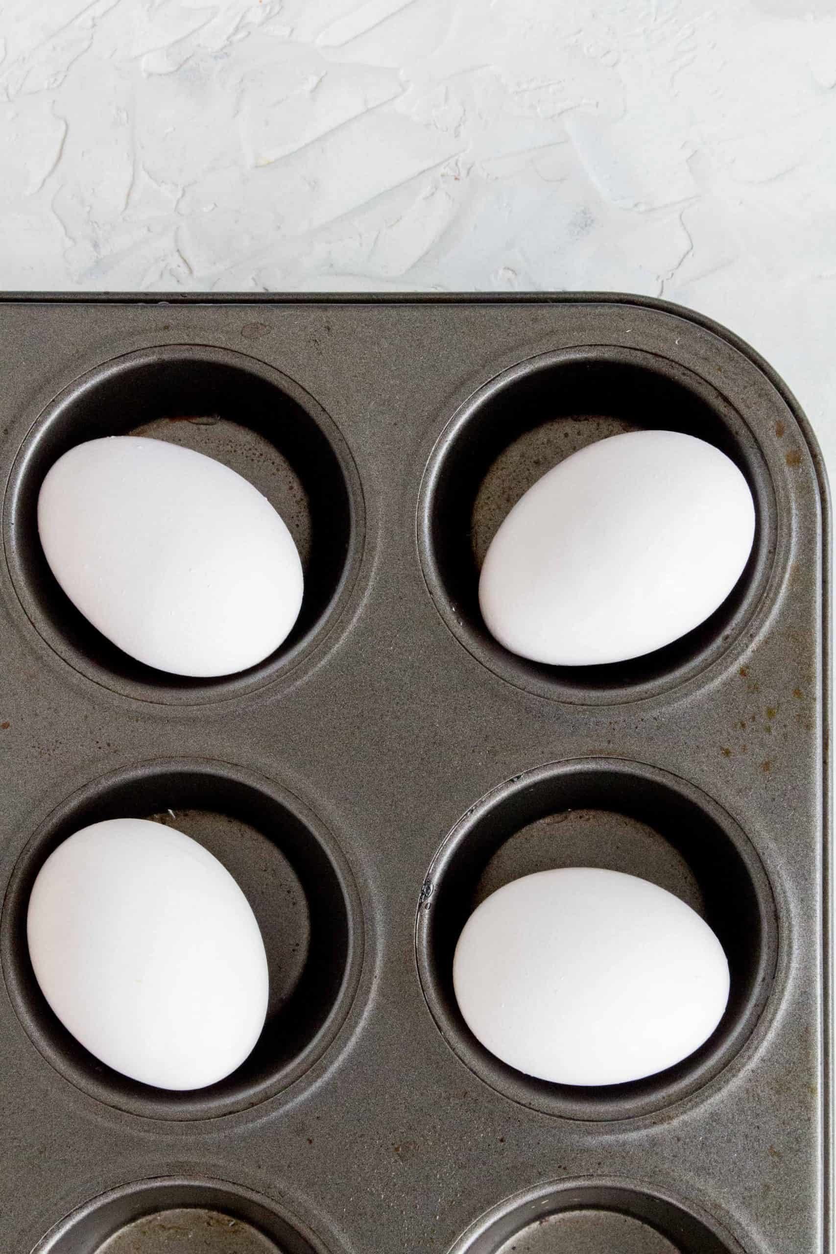 eggs in muffin tin to be baked