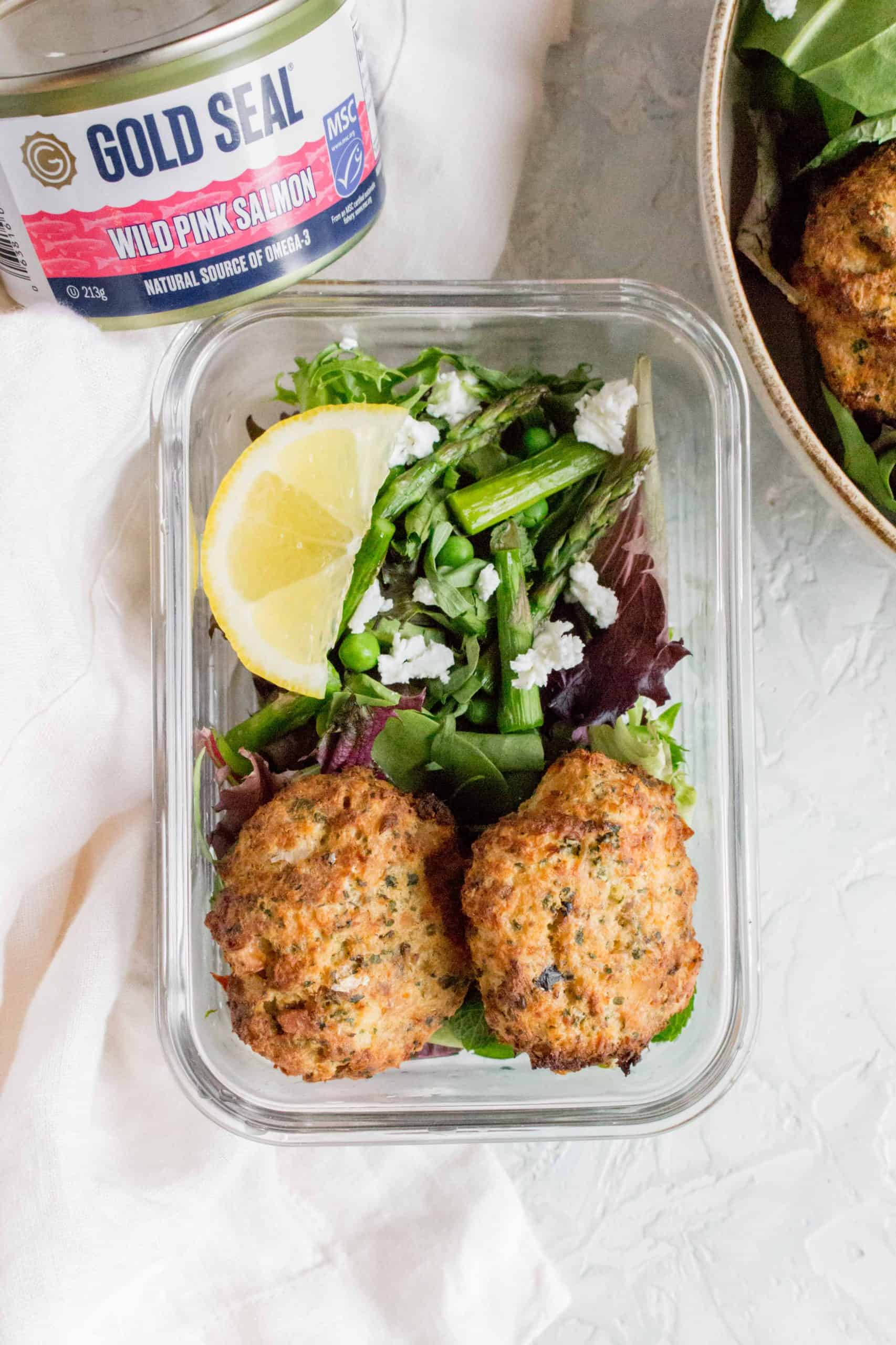 meal prepping salmon patties with salad