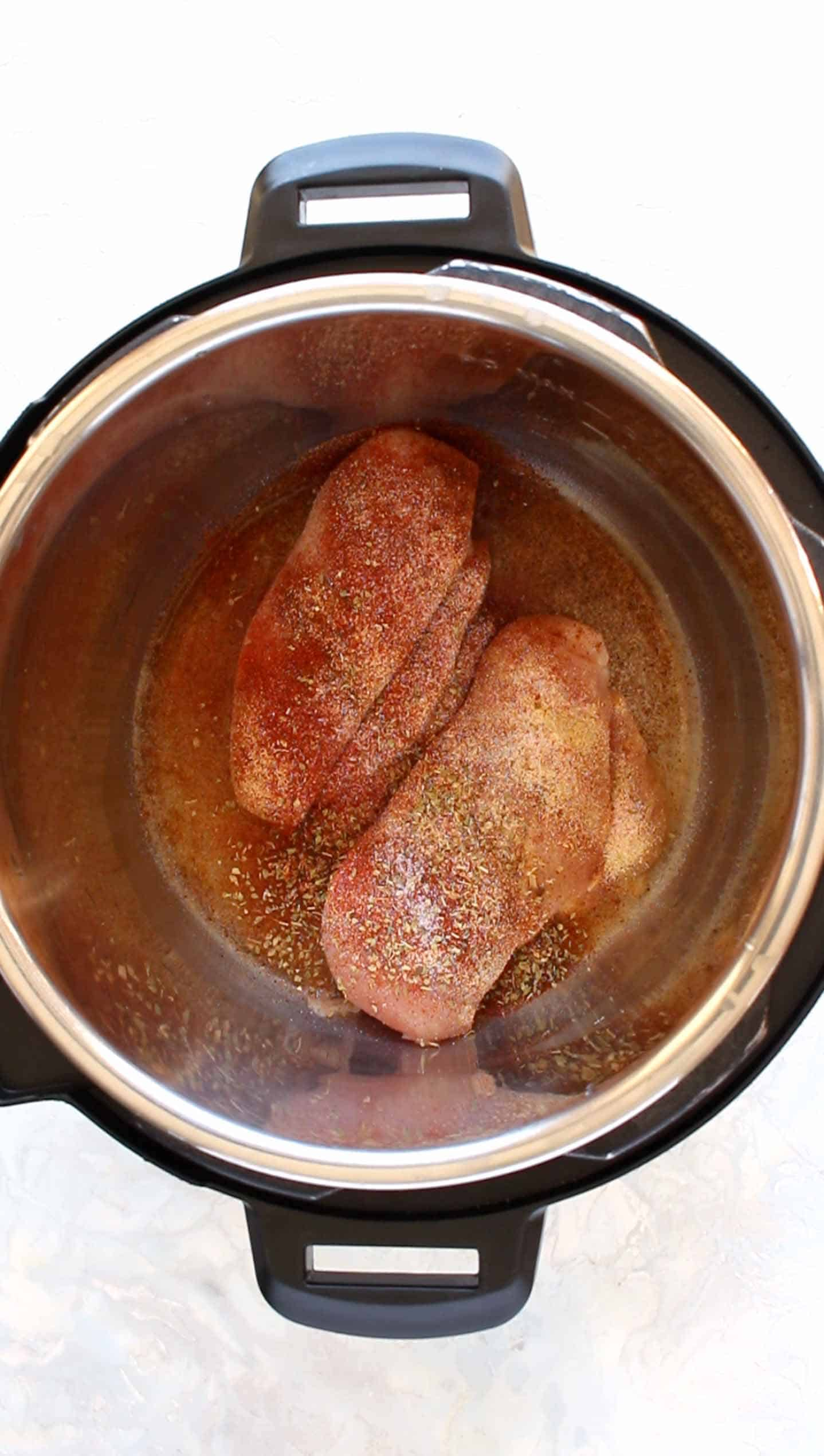Before adding chicken seasoning, add chicken breast and 1/4 cup water to the instant pot.