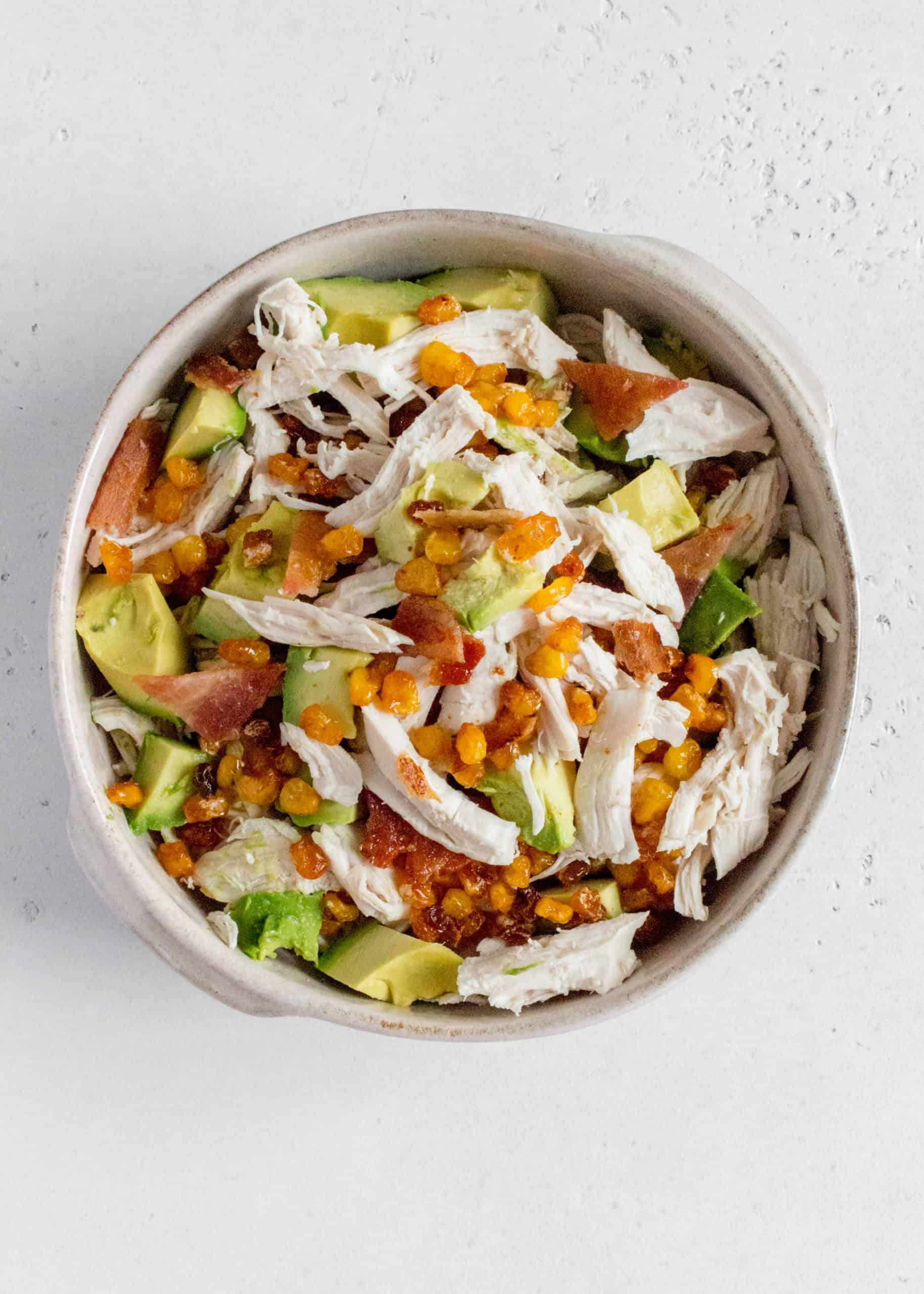 This Simple Avocado Bacon Corn Chicken Salad is perfect summer salad. Easy to put together and super versatile, make this salad for your next bbq!