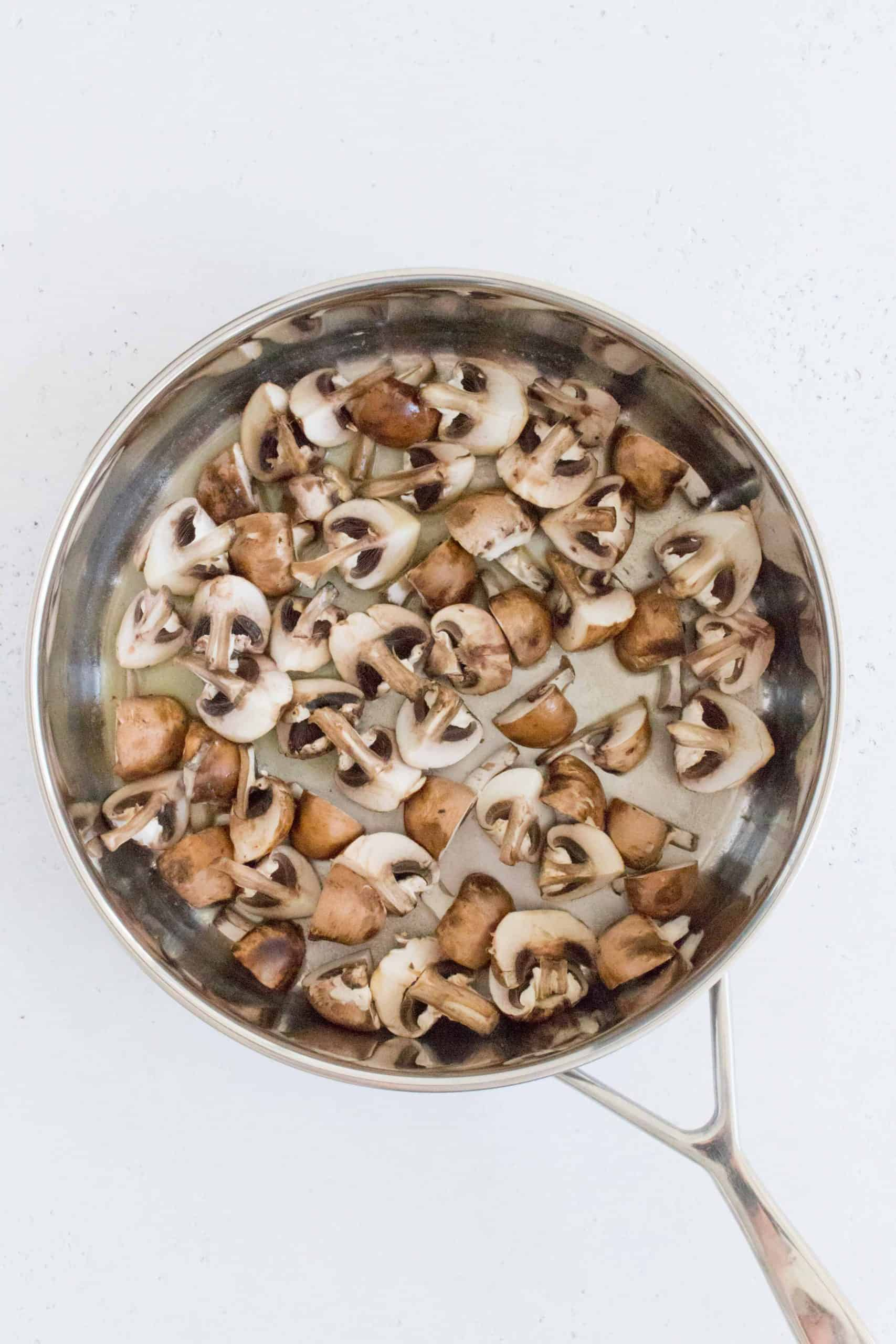 While the water is boiling, in a medium sized pan, melt your butter and sauté the mushrooms.