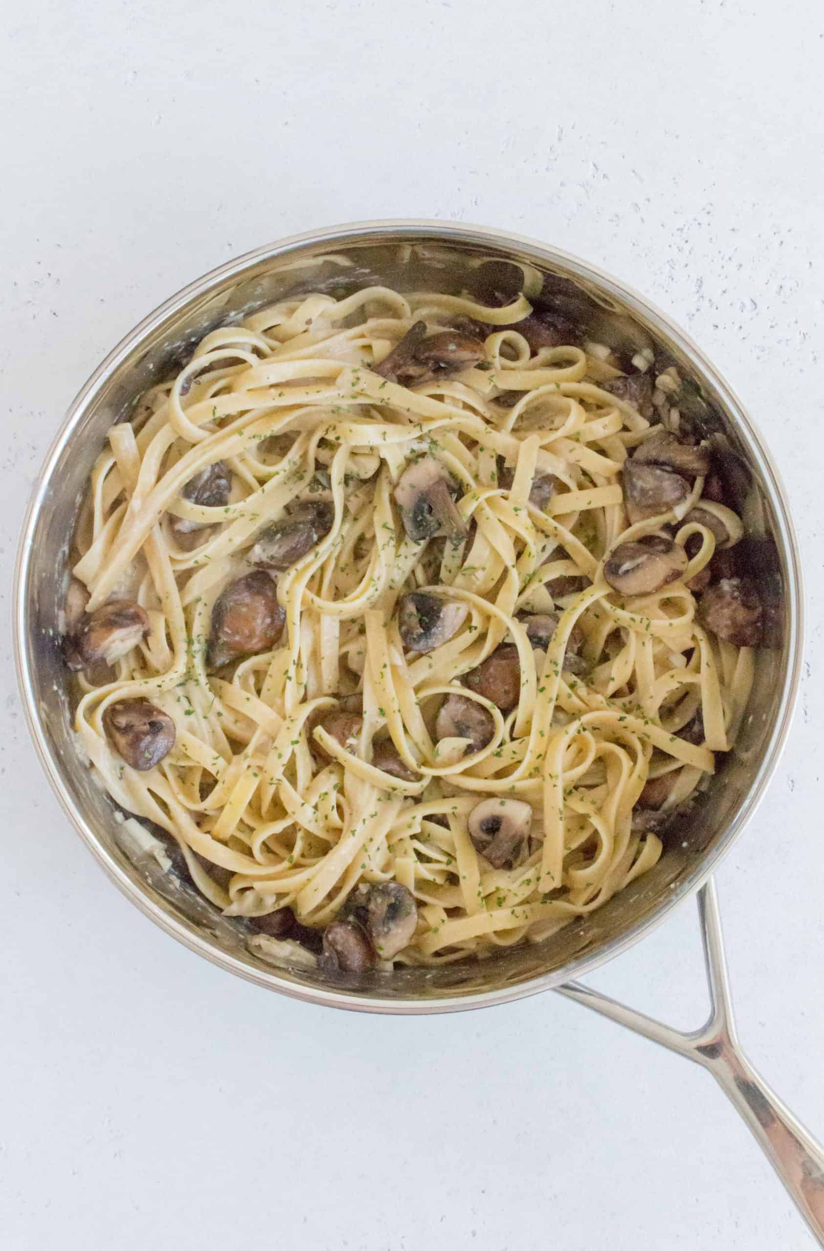Add in the pasta noodles. Pour in the reserved miso paste, pasta water, and parmesan. Stir to combine and to coat the pasta with the sauce.
