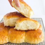 Here's how you can make fluffy, pillowy soft Hokkaido style milk bread rolls at home with this simple recipe. The perfect make ahead bread as they stay soft for days!