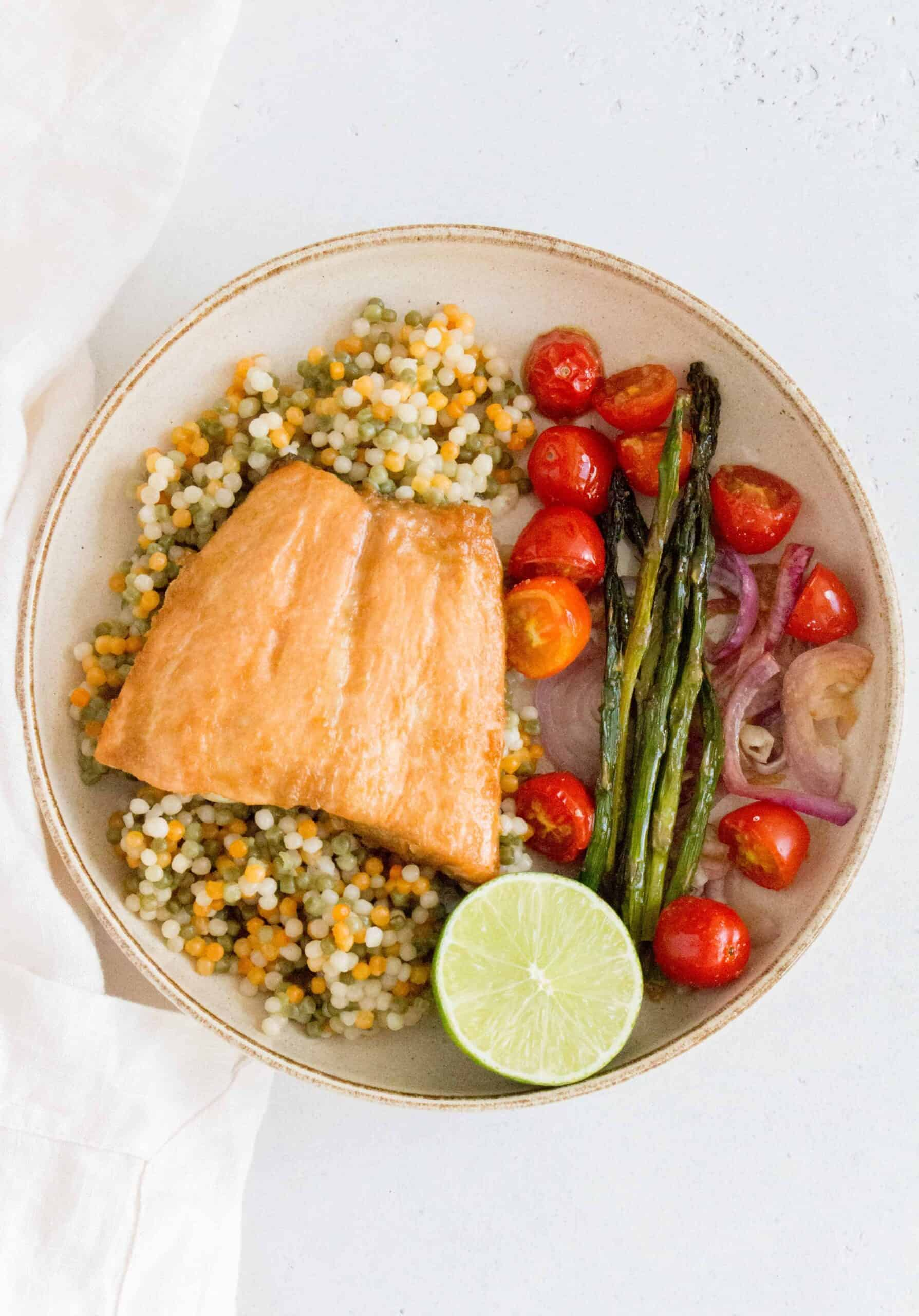 This Sheet Pan Honey Soy Salmon is the easiest dinner! This sheet pan salmon dinner only takes 15 minutes to cook after marinating!
