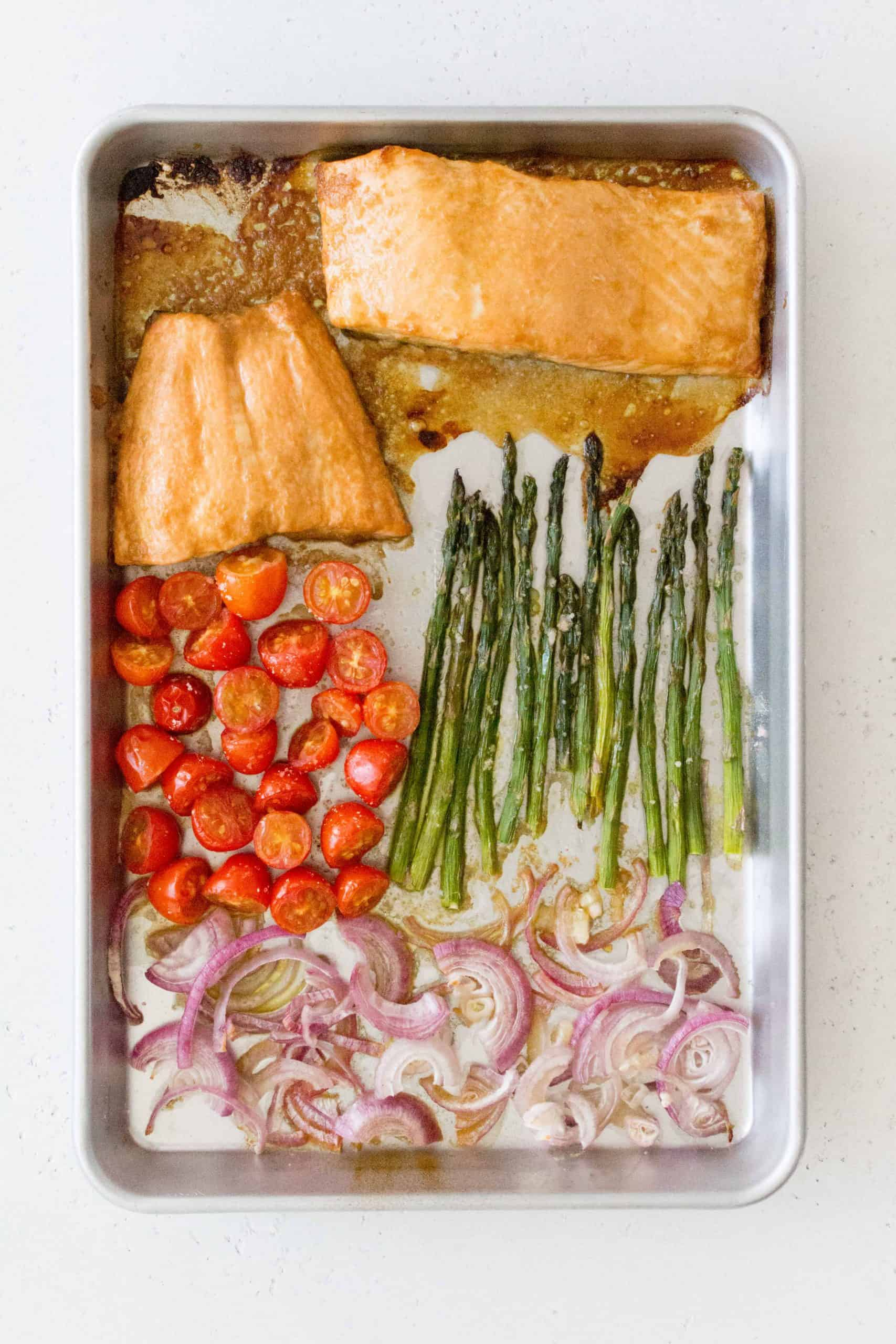sheet pan salmon and asparagus tomatoes and red onions with honey soy marinade