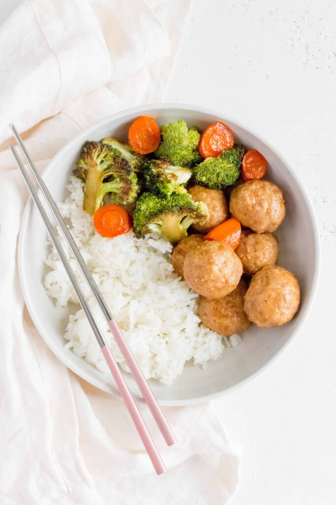 Sweet and tangy, these Chicken Teriyaki Meatballs with Broccoli and Carrots is better than takeout! Make them at home today or freeze them for later.